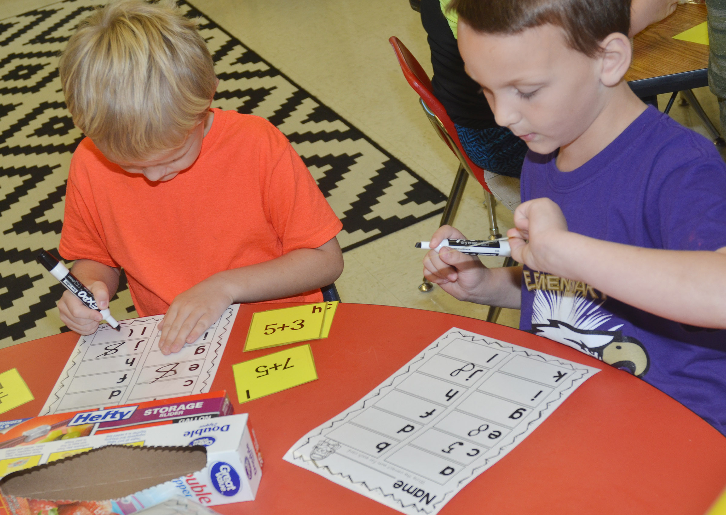 CES first-graders Tristian Harris, at left, and Justice Nelson work math problems.