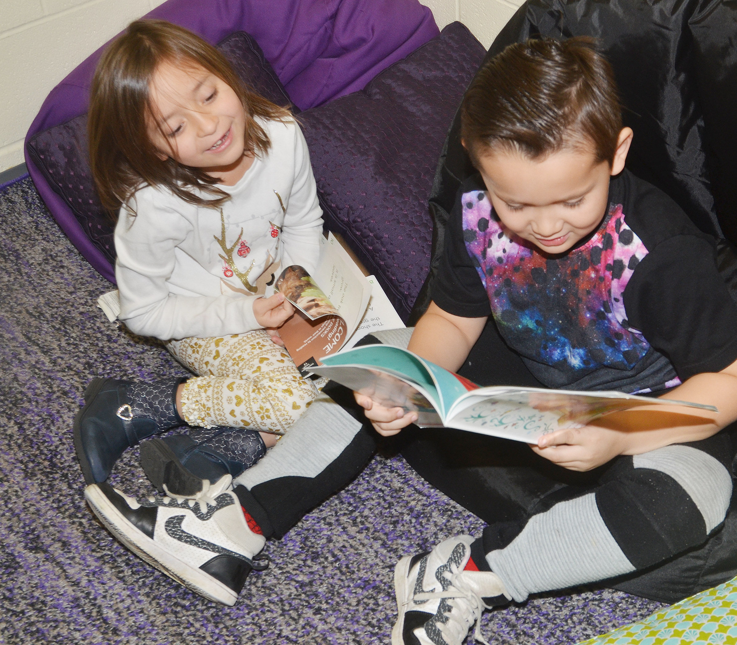 CES first-grader Karter Young reads to classmate Gabriella Tate.