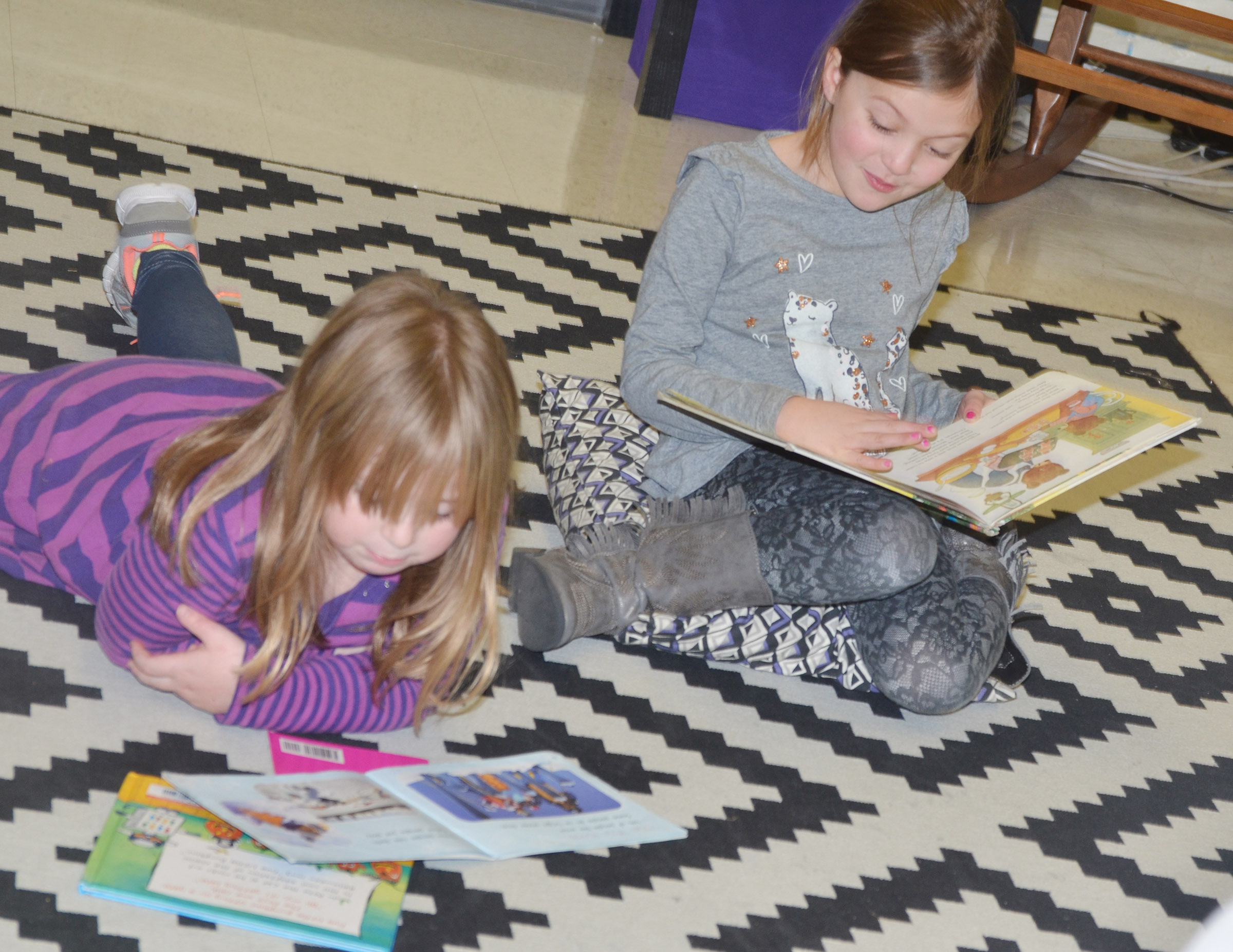 CES first-graders Briley Sapp, at left, and Delaney Staton read together.