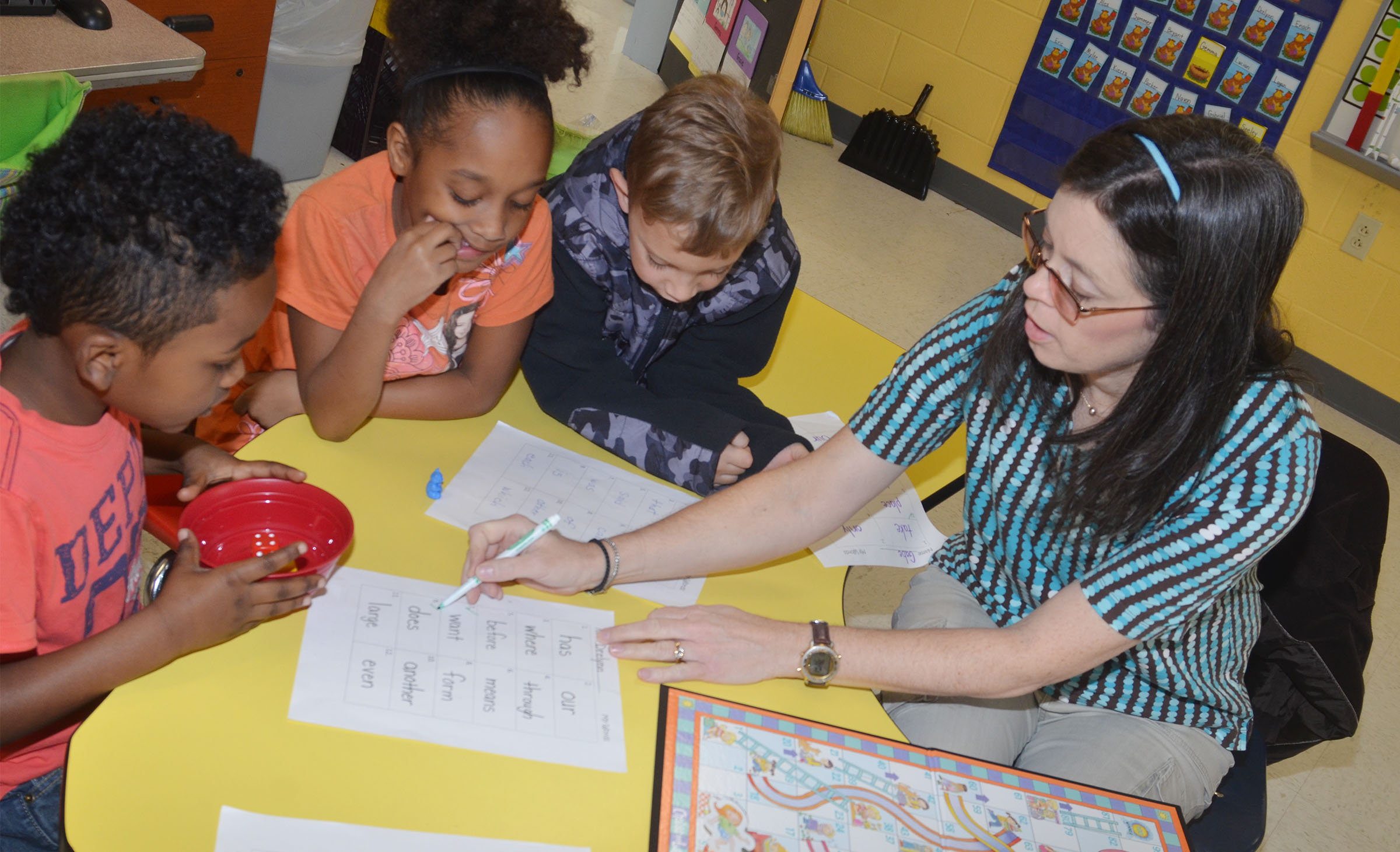 CES first-grade teacher Shirley Cox plays Candyland with students, from left, first-grader Drelynn Hollins, second-grader Lashonda Wilkinson and first-grader Gabe Prior to help them learn sight words.