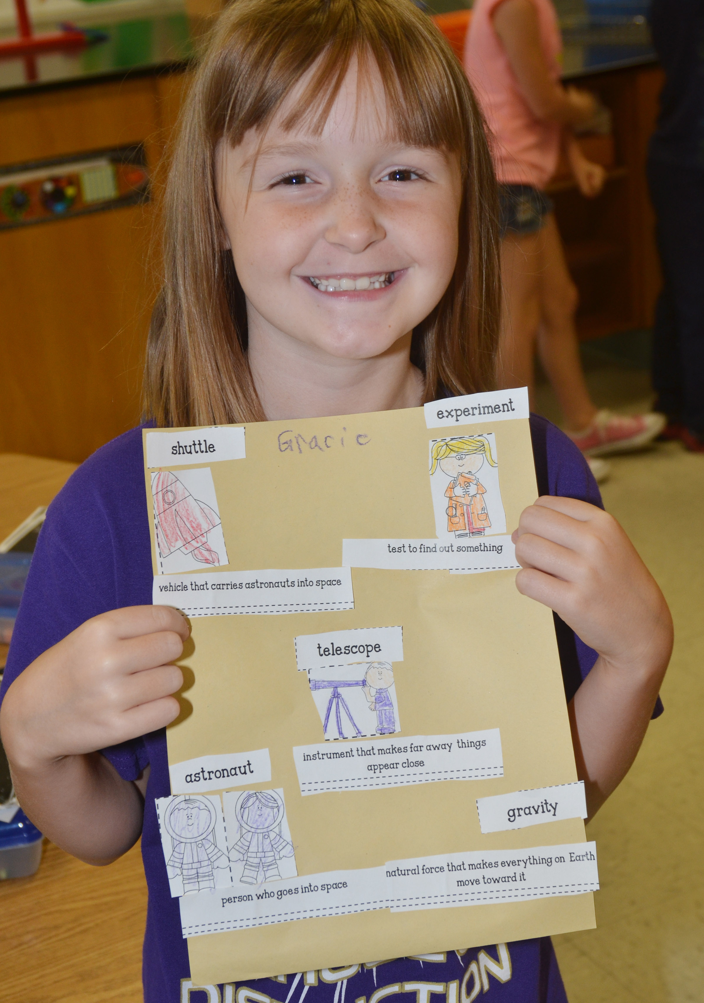 CES second-grader Gracie Murphy holds her finished space vocabulary sheet.