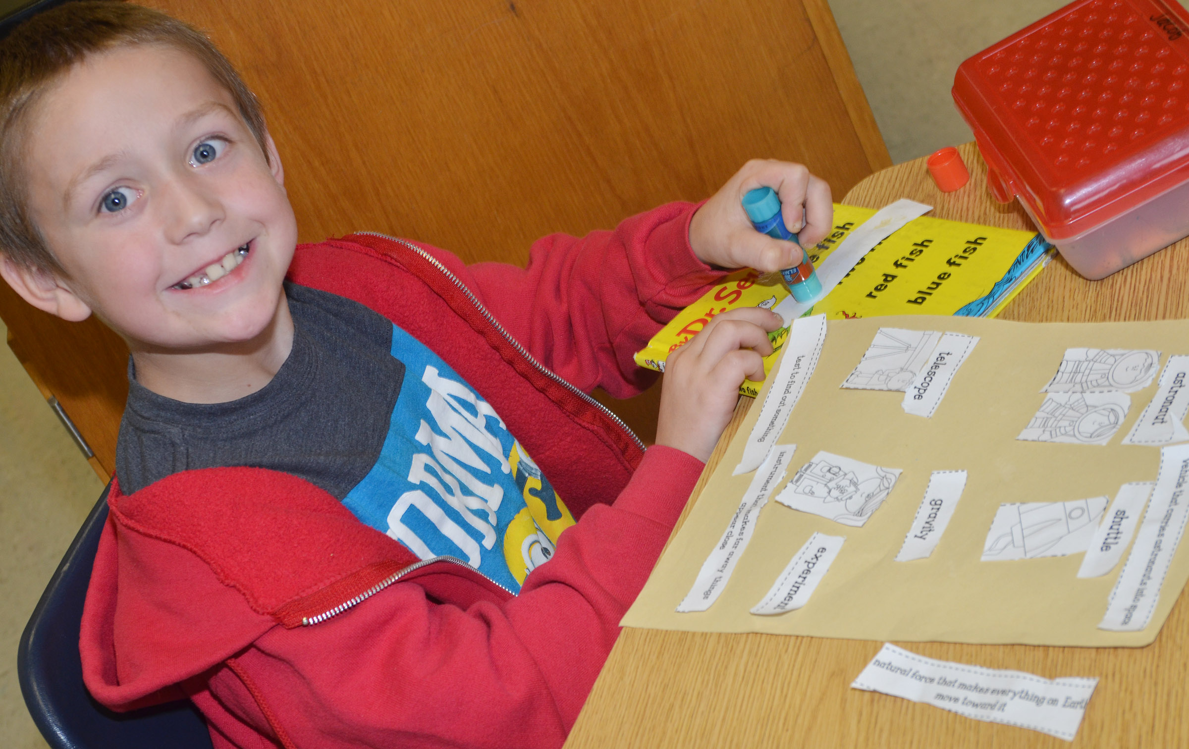 CES second-grader Jacob Golden glues his space definitions with the correct pictures.