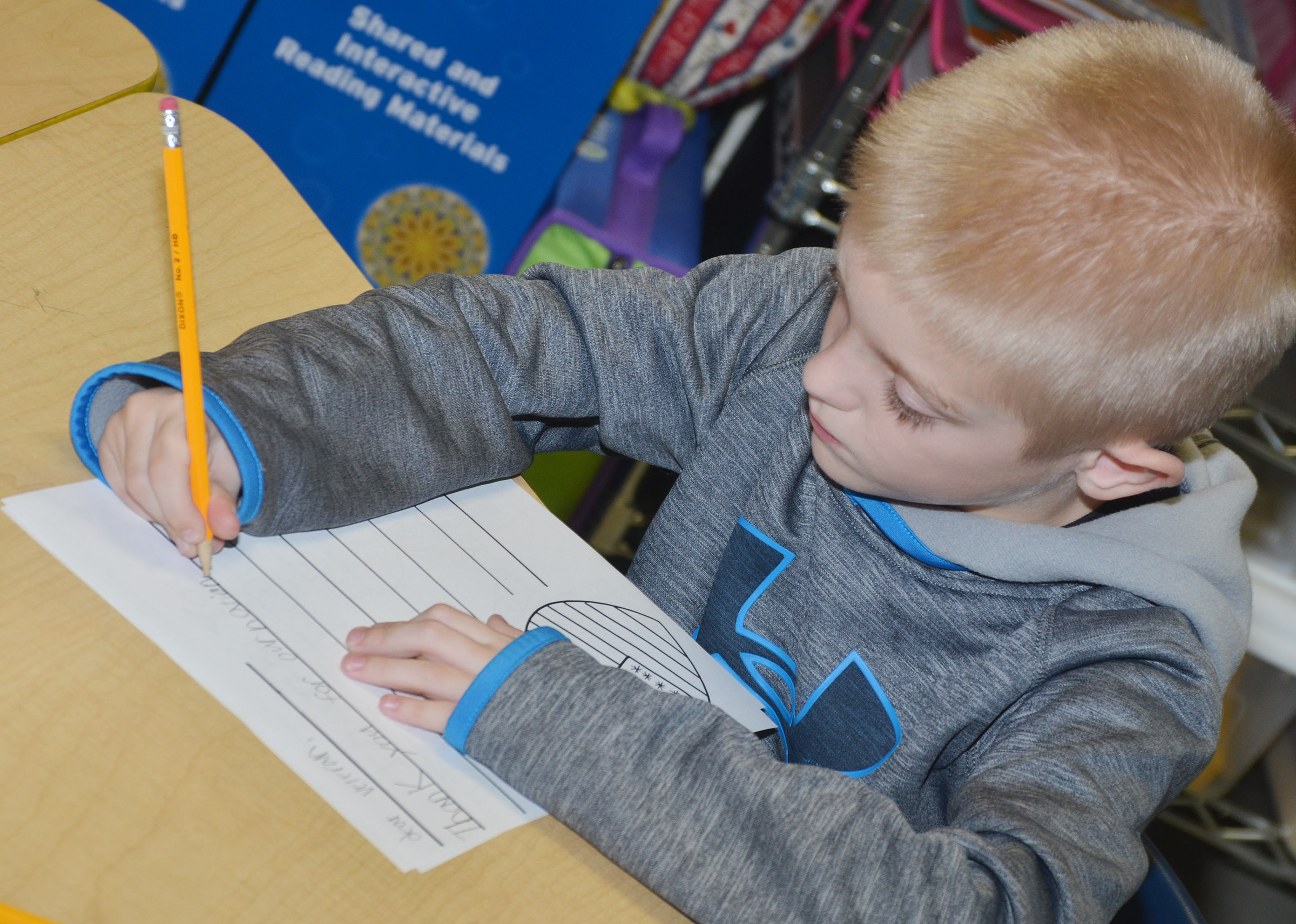 CES third-grader Evan Cundiff writes a letter to a veteran.