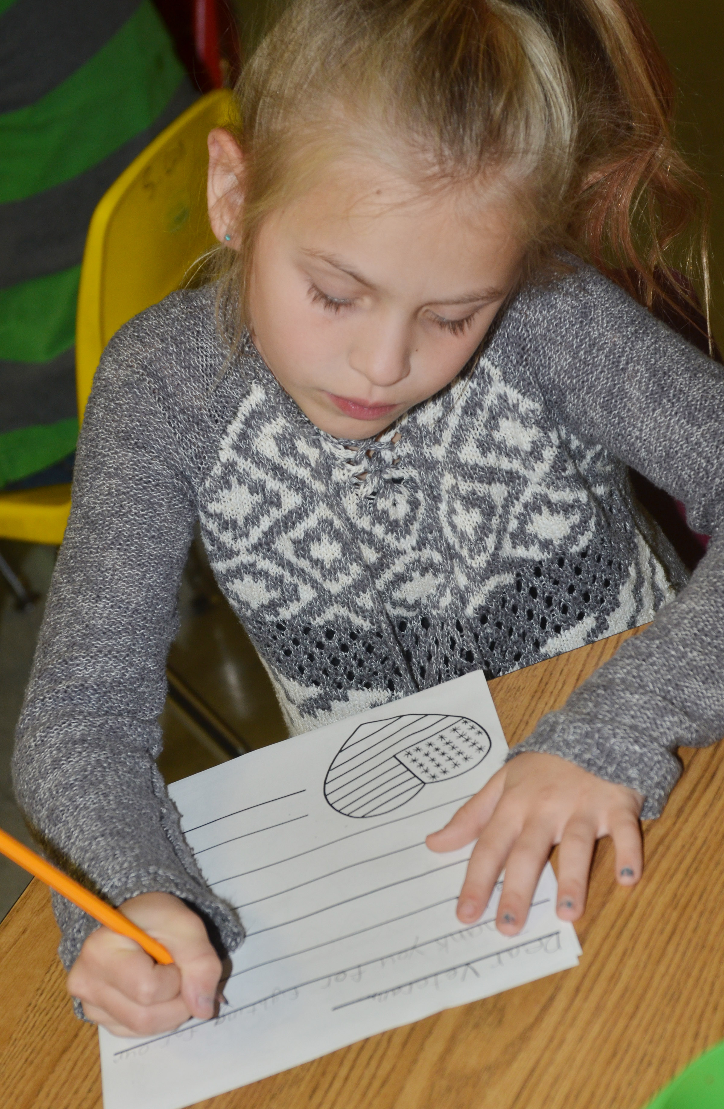 CES third-grader Ava Ellis writes a letter to a veteran.