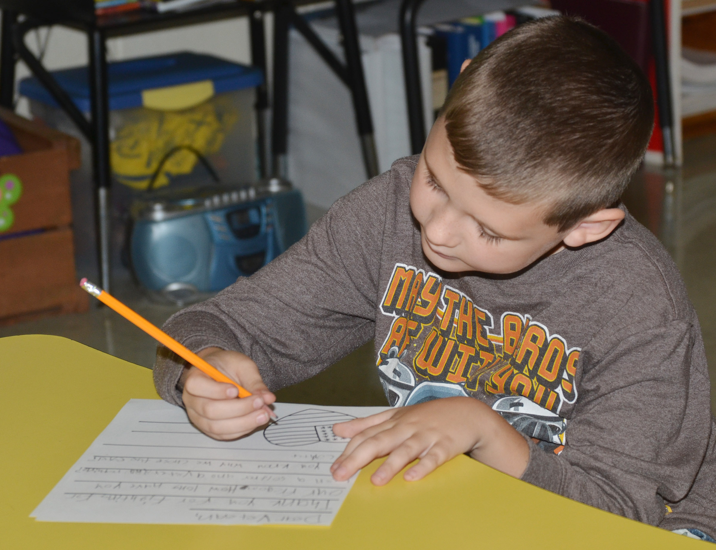 CES third-grader Ryan Tungate writes a letter to a veteran.
