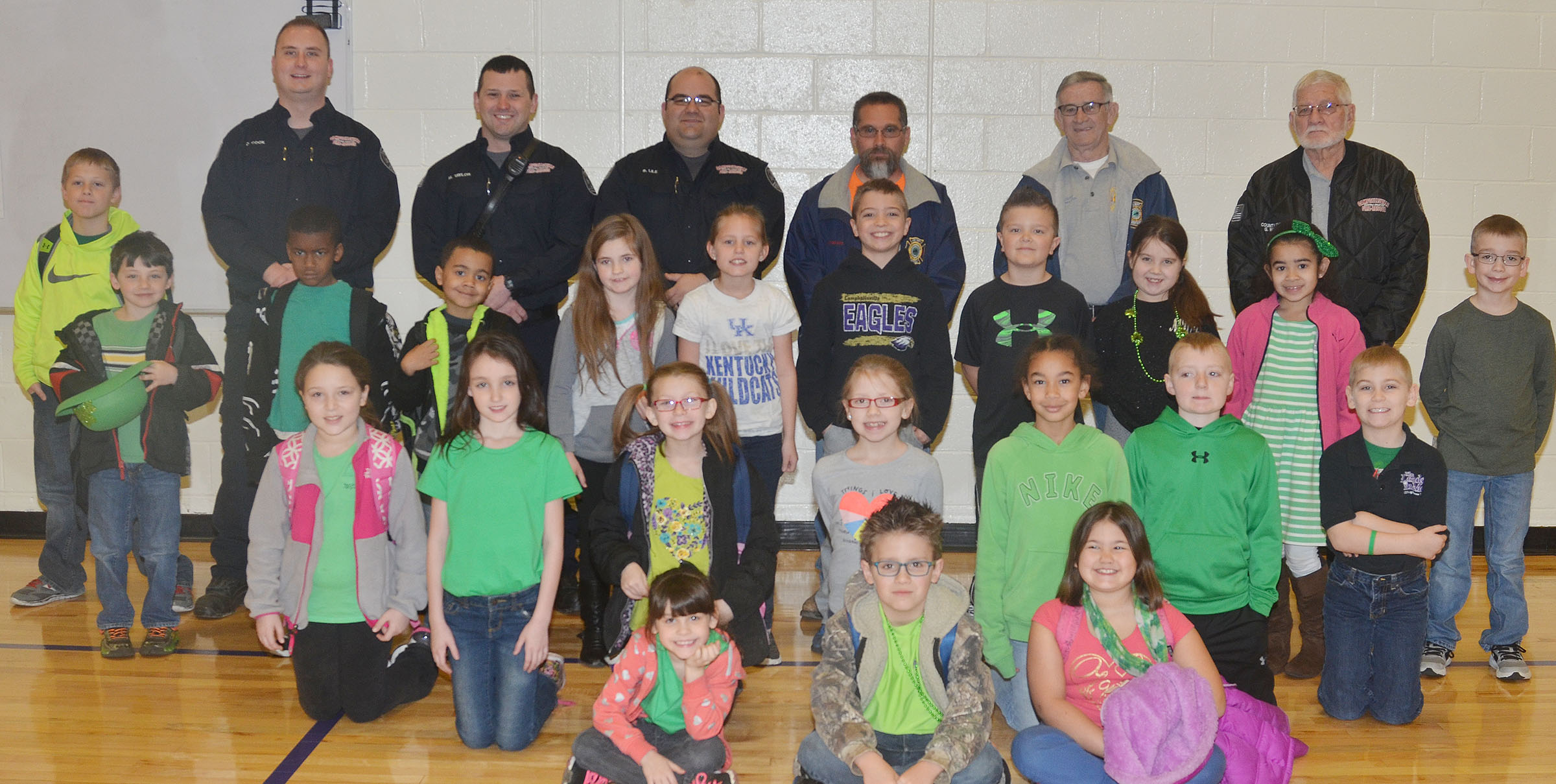 From left, front, are first-grader Phoebe Ritchie and second-graders Dalton Shively and Marissa Sumners. Second row, second-grader Keely Rakes, third-grader Paige Ritchie, second-grader Sammantha Wooley, third-graders Gracie Pendleton, De'Asia Fisher and Ryder Murphy and second-grader Joseph Greer. Third row, second-graders Codey Parks and Kae'vin Spaulding, first-graders Trace Richardson and Bree Farmer, third-graders Madisyn Bradfield and Carson Mills, second-grader Cayton Lawhorn, third-grader Maylee Wilds, second-grader Sophia Santos and third-grader Cameron Estes. Back, second-grader Evan Lockridge, Campbellsville Fire & Rescue firefighters Daniel Cook and Matthew Taylor and Captain Brent Lile, Taylor County Fire Department volunteer Randy Bricken Jr., Assistant Chief Randy Bricken Sr. and Chief George Wilson.