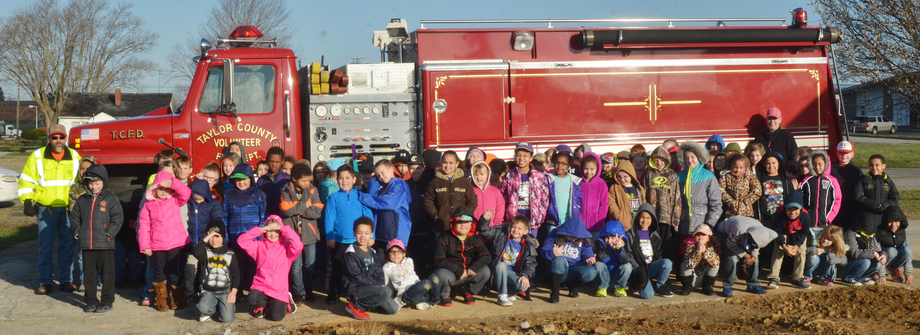 CES first-grade students take a photo with a Taylor County Fire Department truck. At left is CES custodian Randy Bricken Jr., who is a volunteer at the fire department.