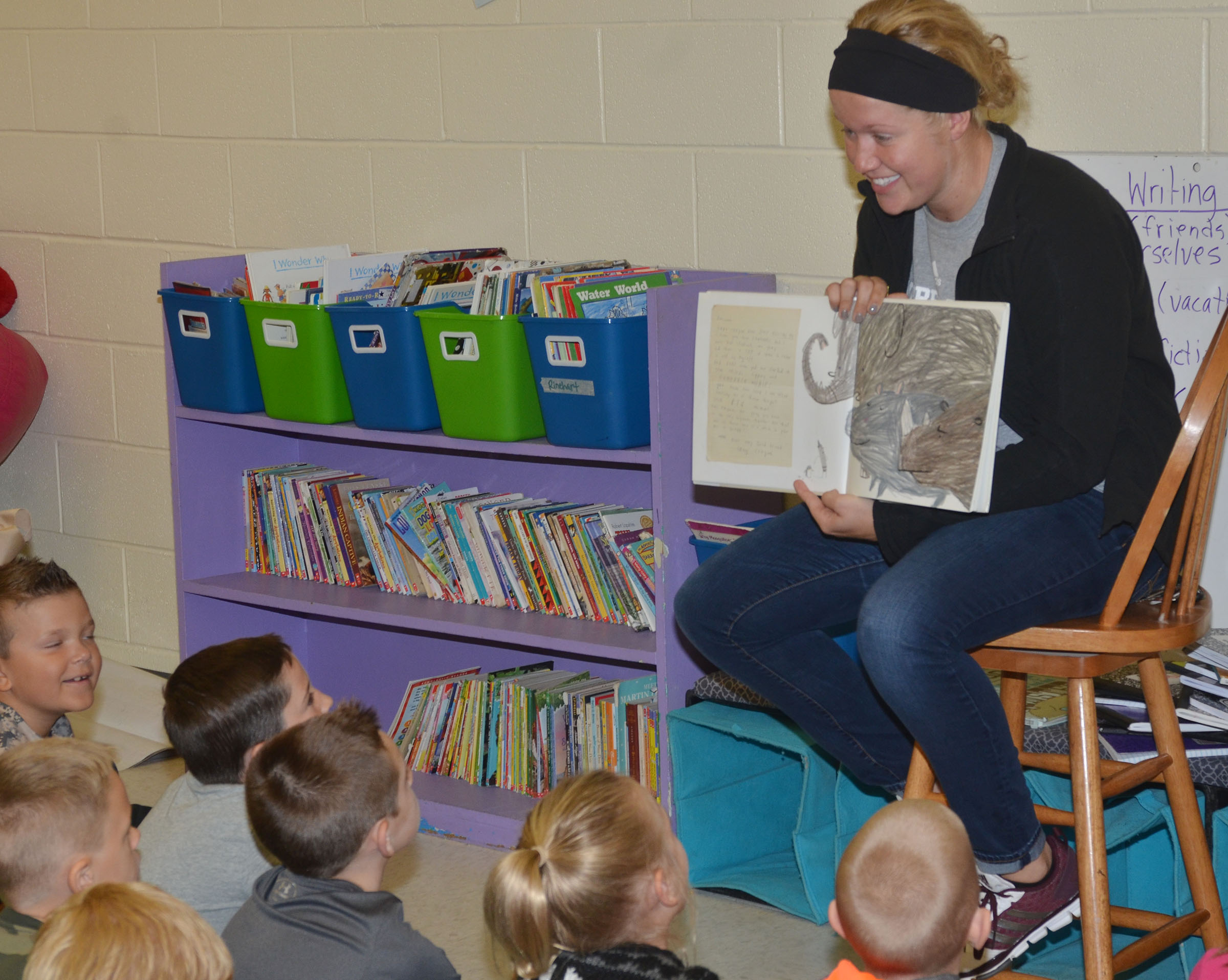 CU softball player Maddie Sweeney reads to CES second-graders.