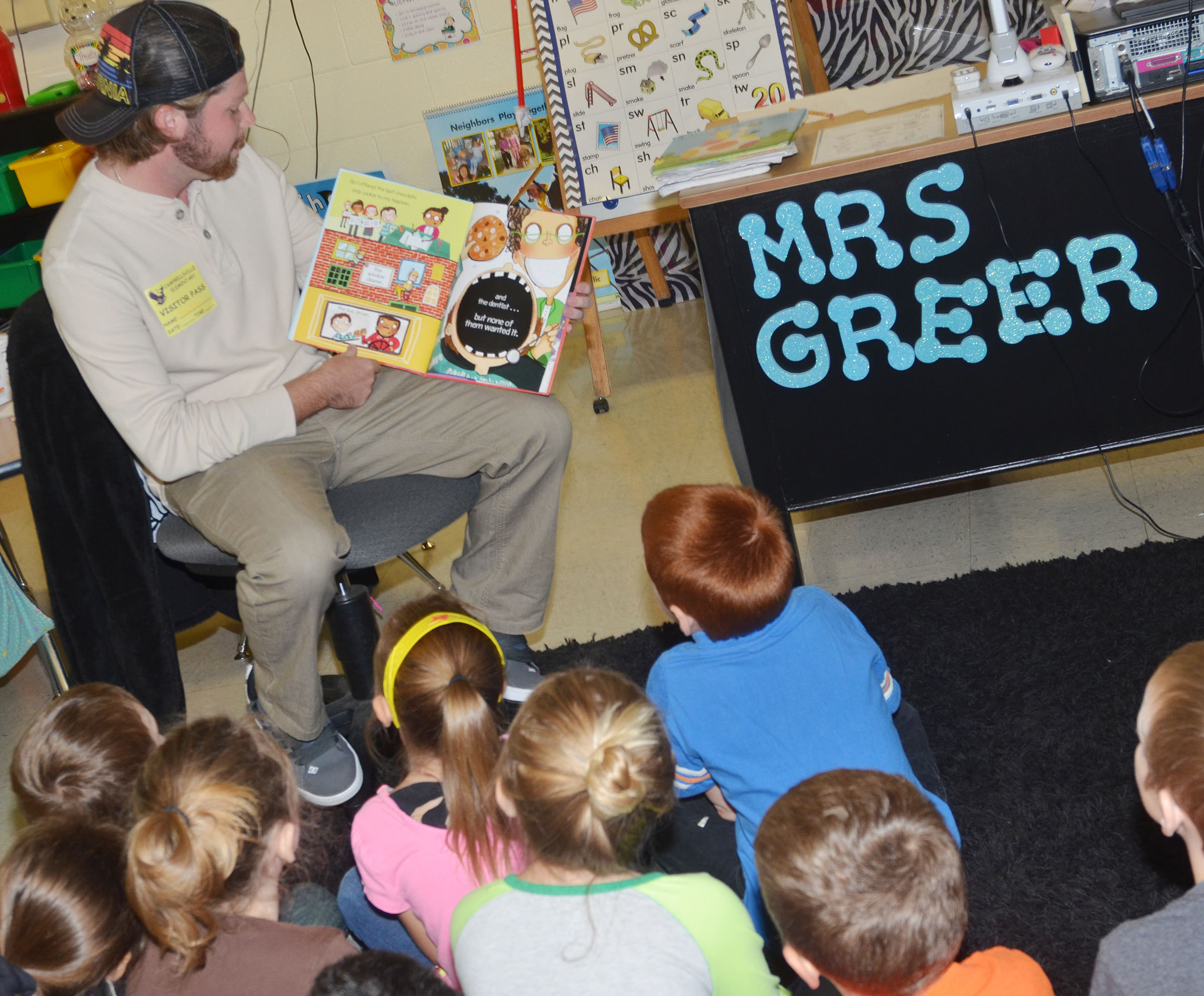 CU golf player Robbie Johnson reads to CES first-graders in Amanda Greer's class.