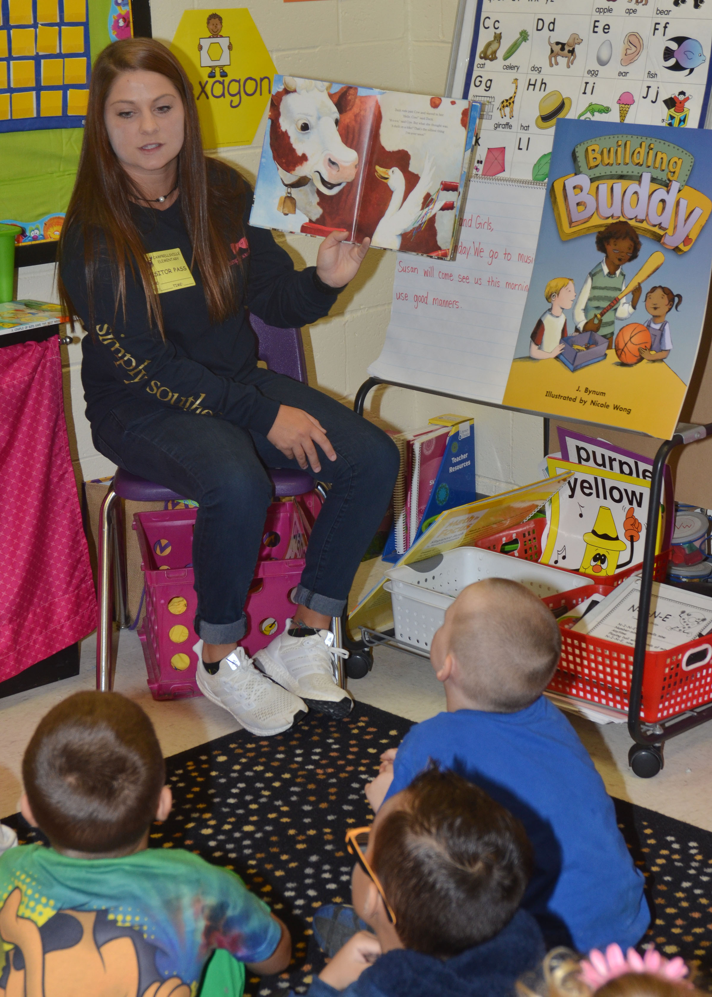 CU golf player Cassidy Scantland reads to CES kindergarteners.