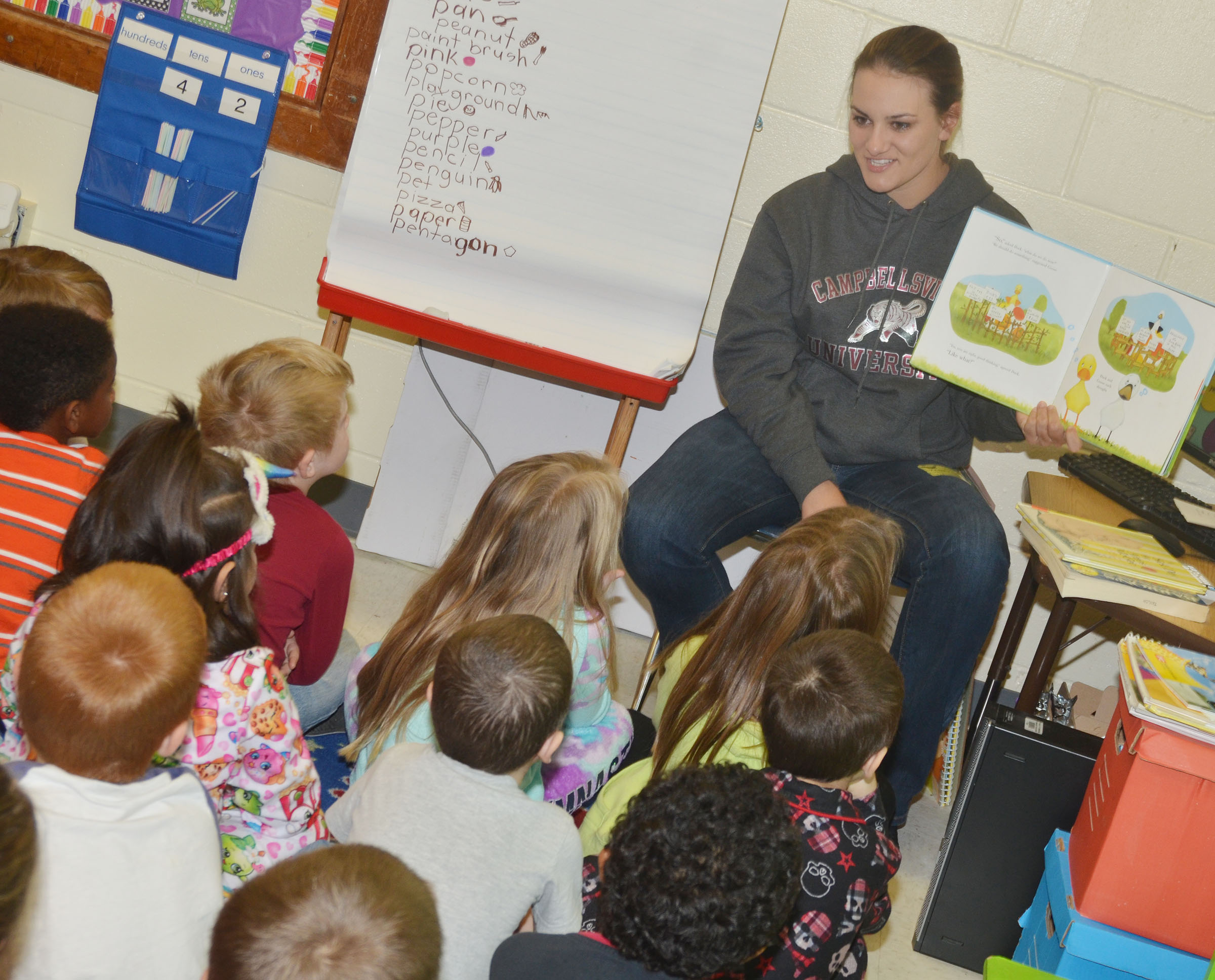 CU golf player Ashley Goodin reads to CES kindergarteners.
