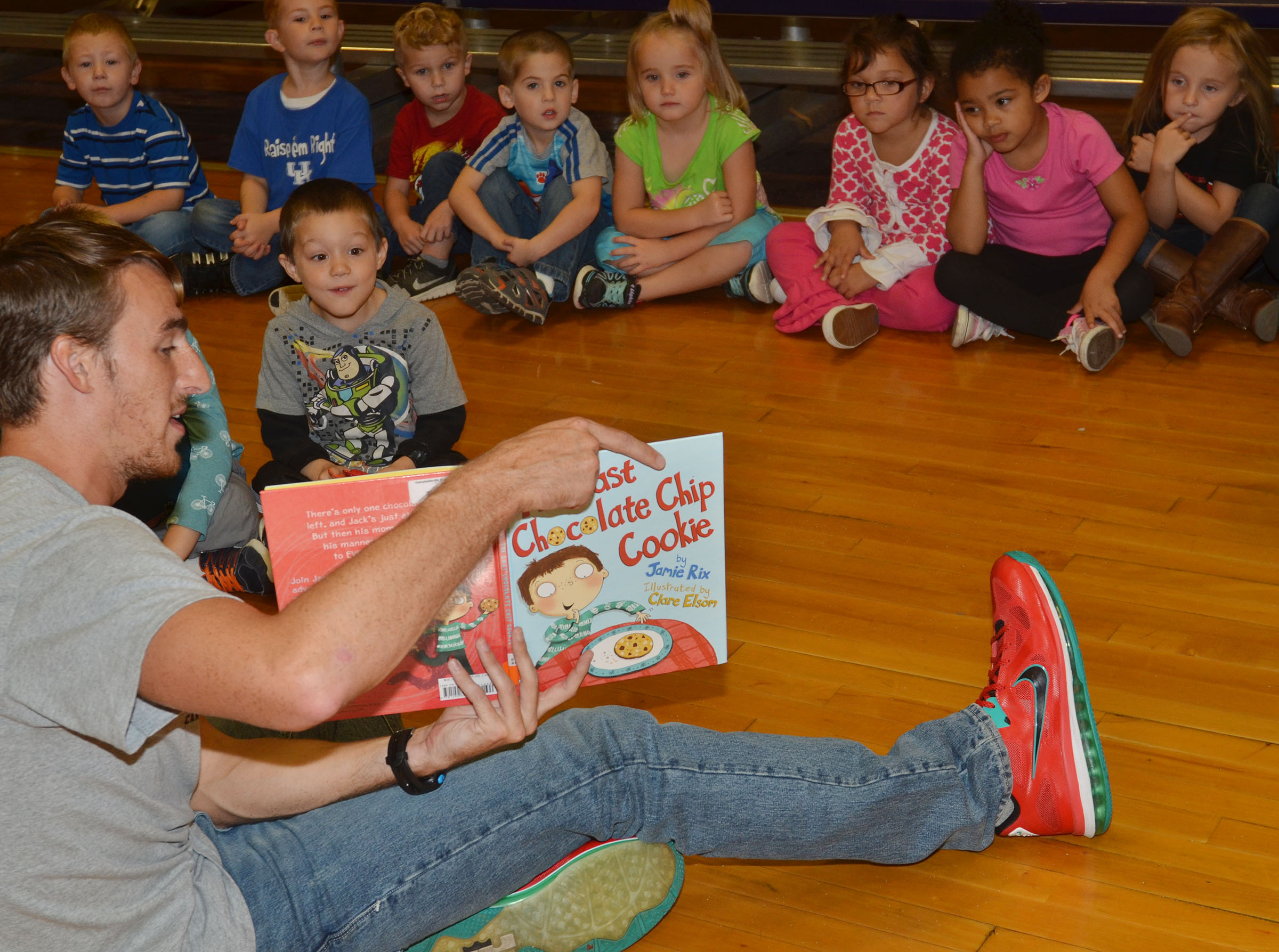CU cross country runner Brandon Wiseheart reads to CES preschool students.