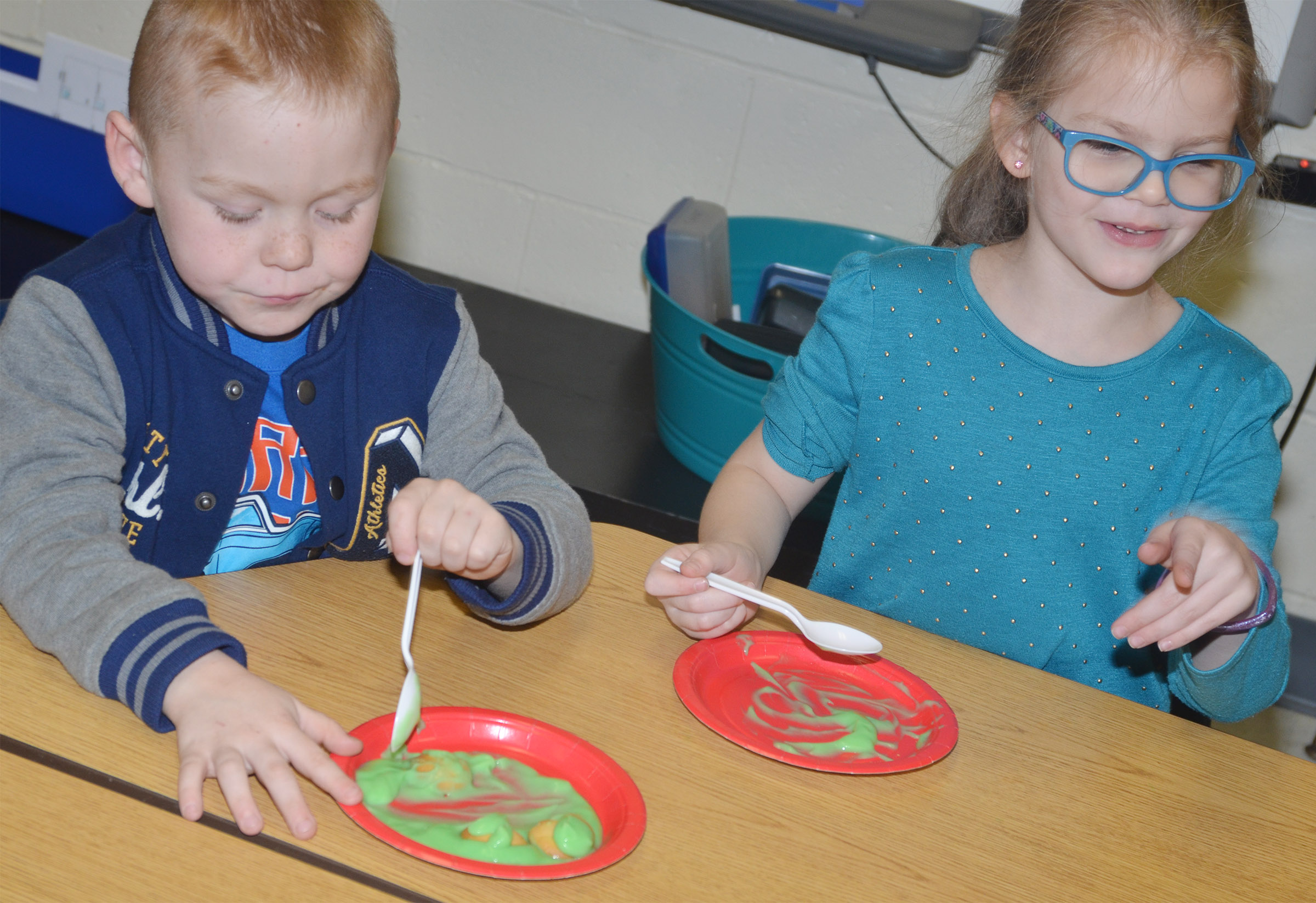 CES kindergarteners Daven Davis, at left, and Zoe Weddle sample green eggs and ham.