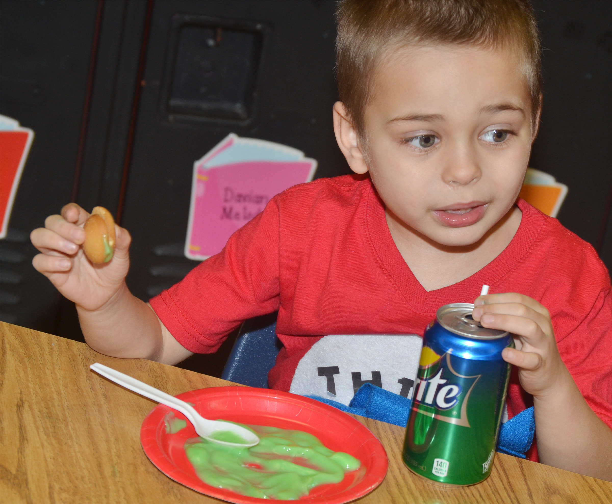 CES kindergartener Michael Terry samples green eggs and ham.