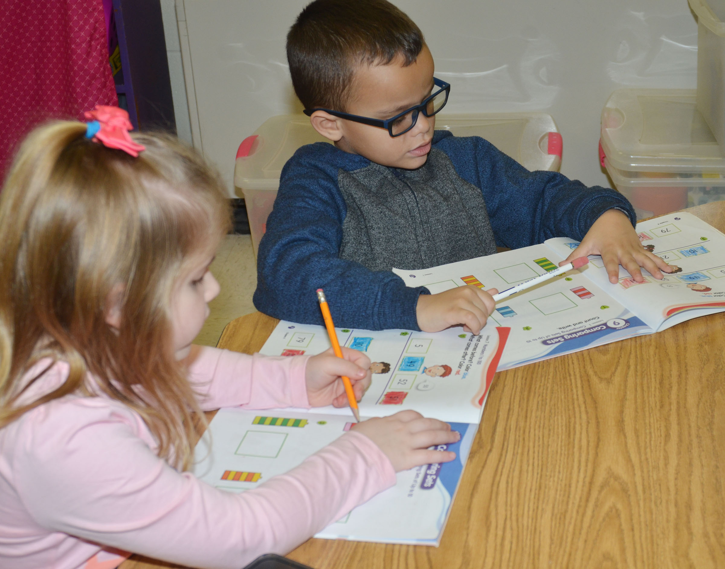 CES kindergarteners Aubreigh Knifley and Davian Taylor work math problems.