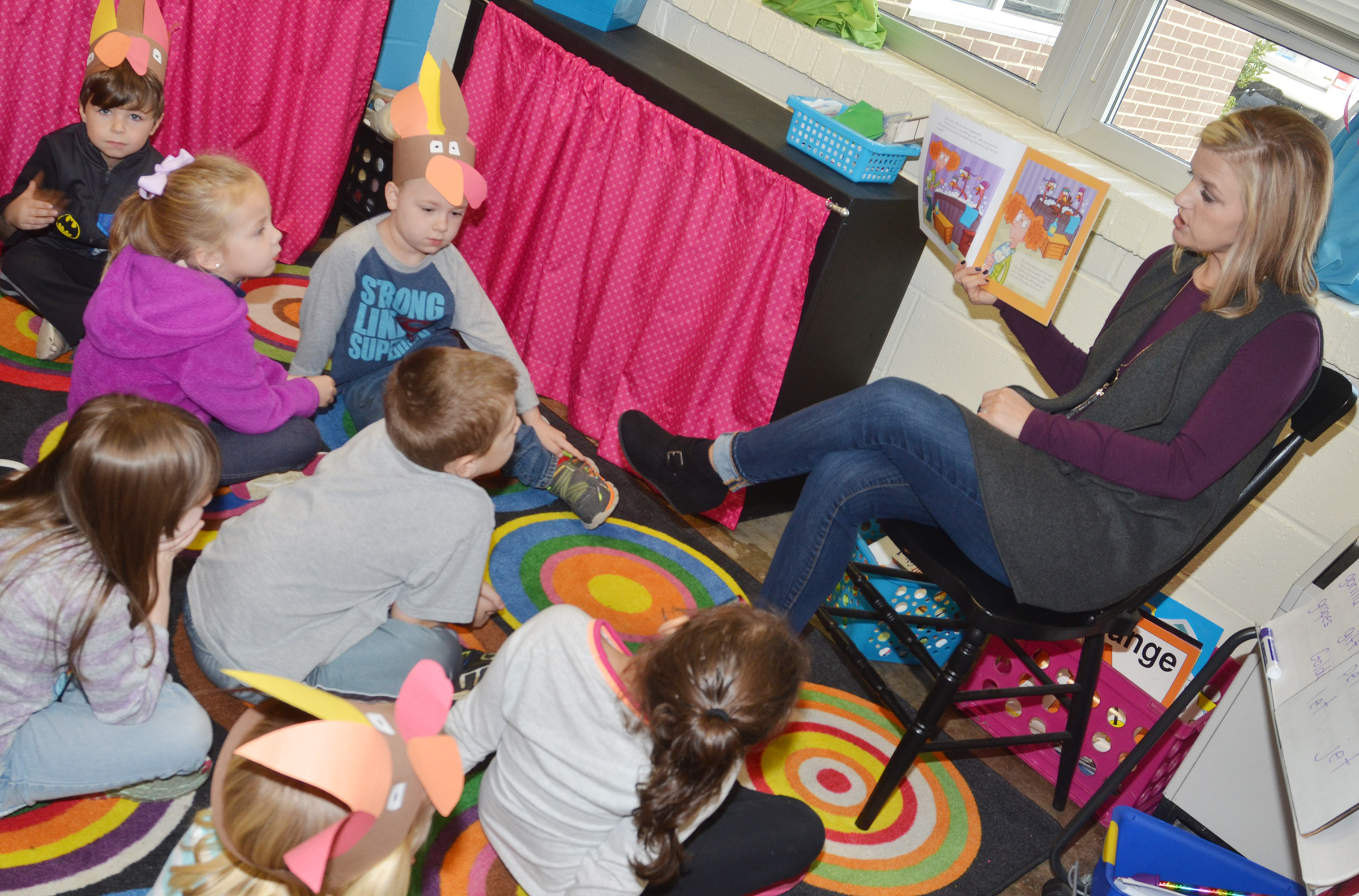 "CES kindergarten teacher Leanna Cundiff reads ""The Silly Turkey Party"" by Steve Metzger to her students."