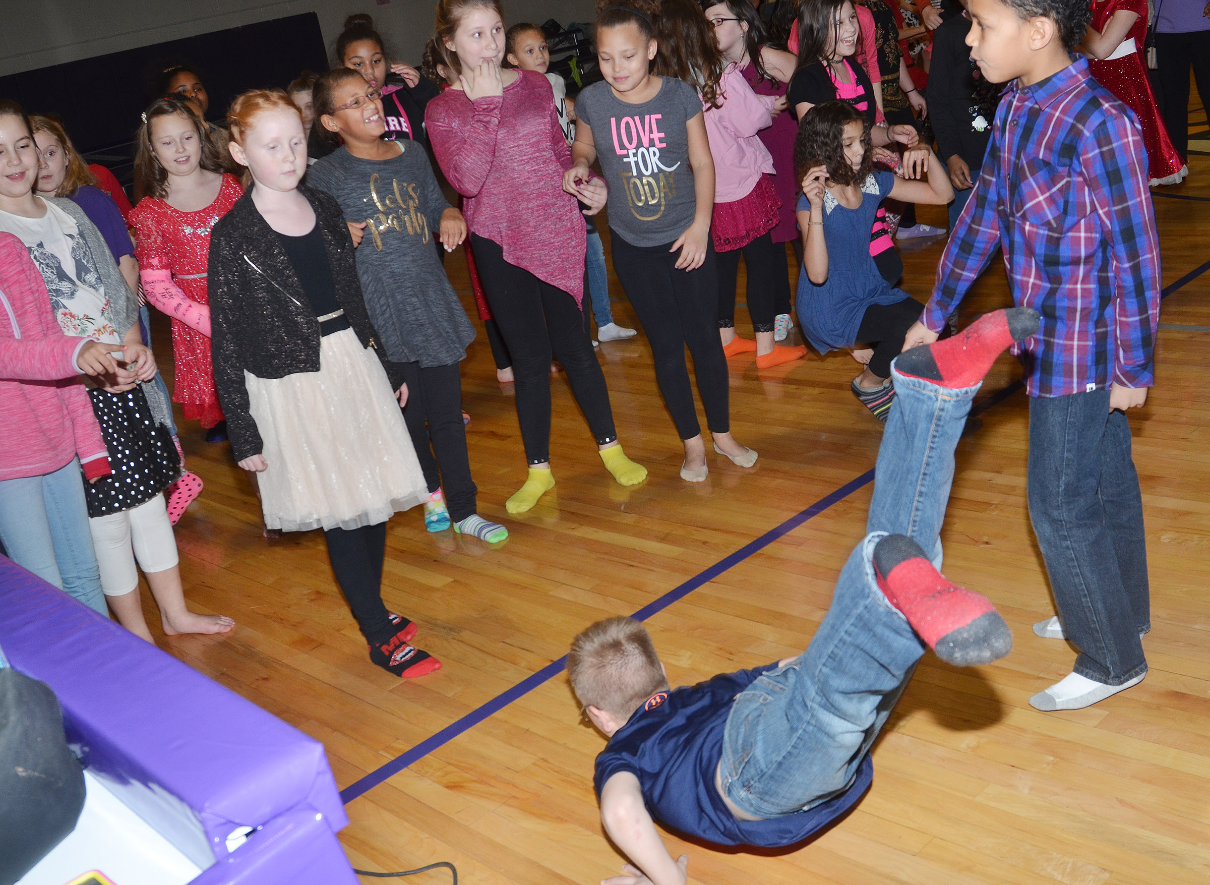 CES fourth-graders Nora Harris, at left, and Ethan Irwin compete in a dance battle.