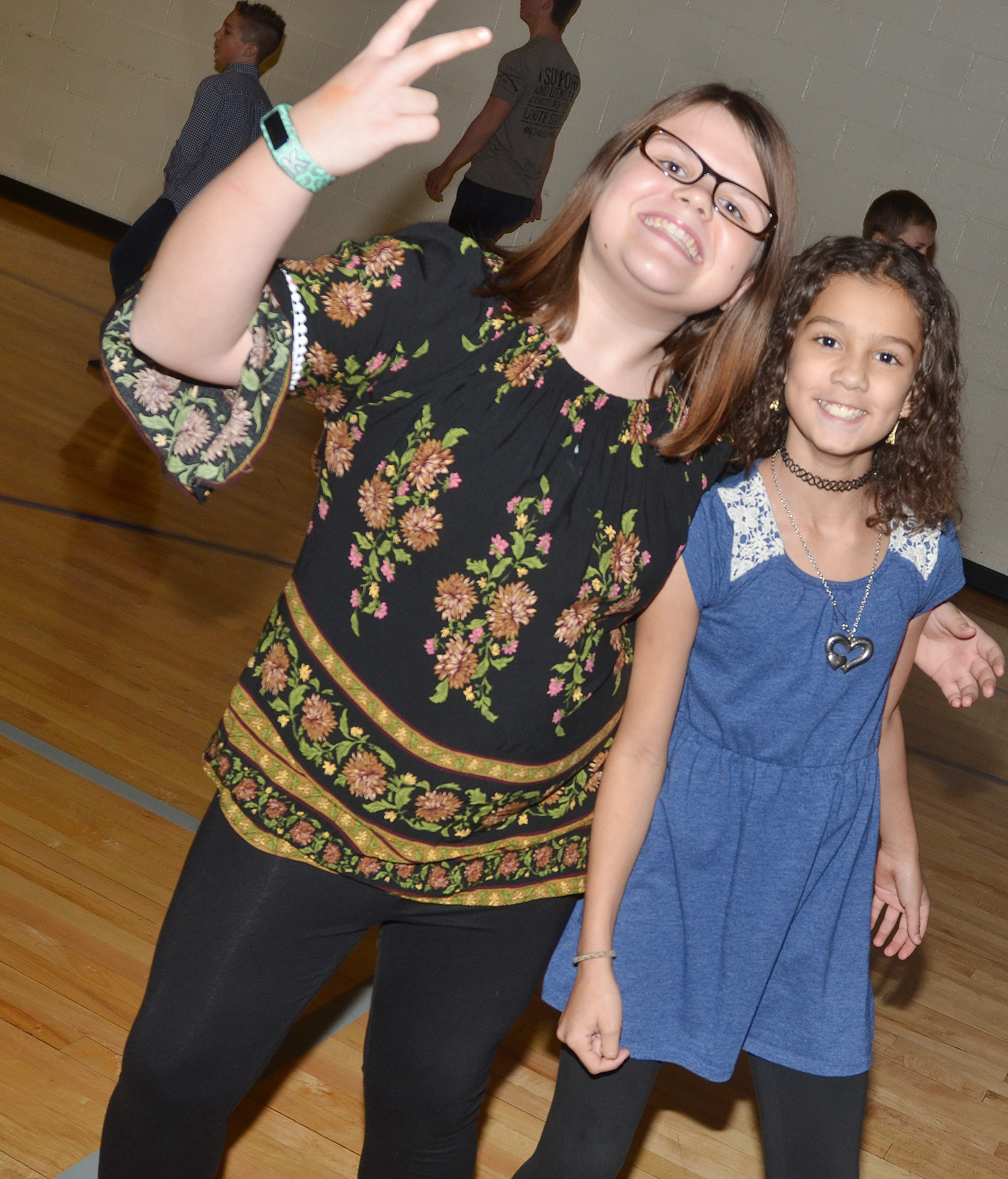 CES fifth-graders Keely Dicken, at left, and Mackenzie Negron smile for a photo at the dance.