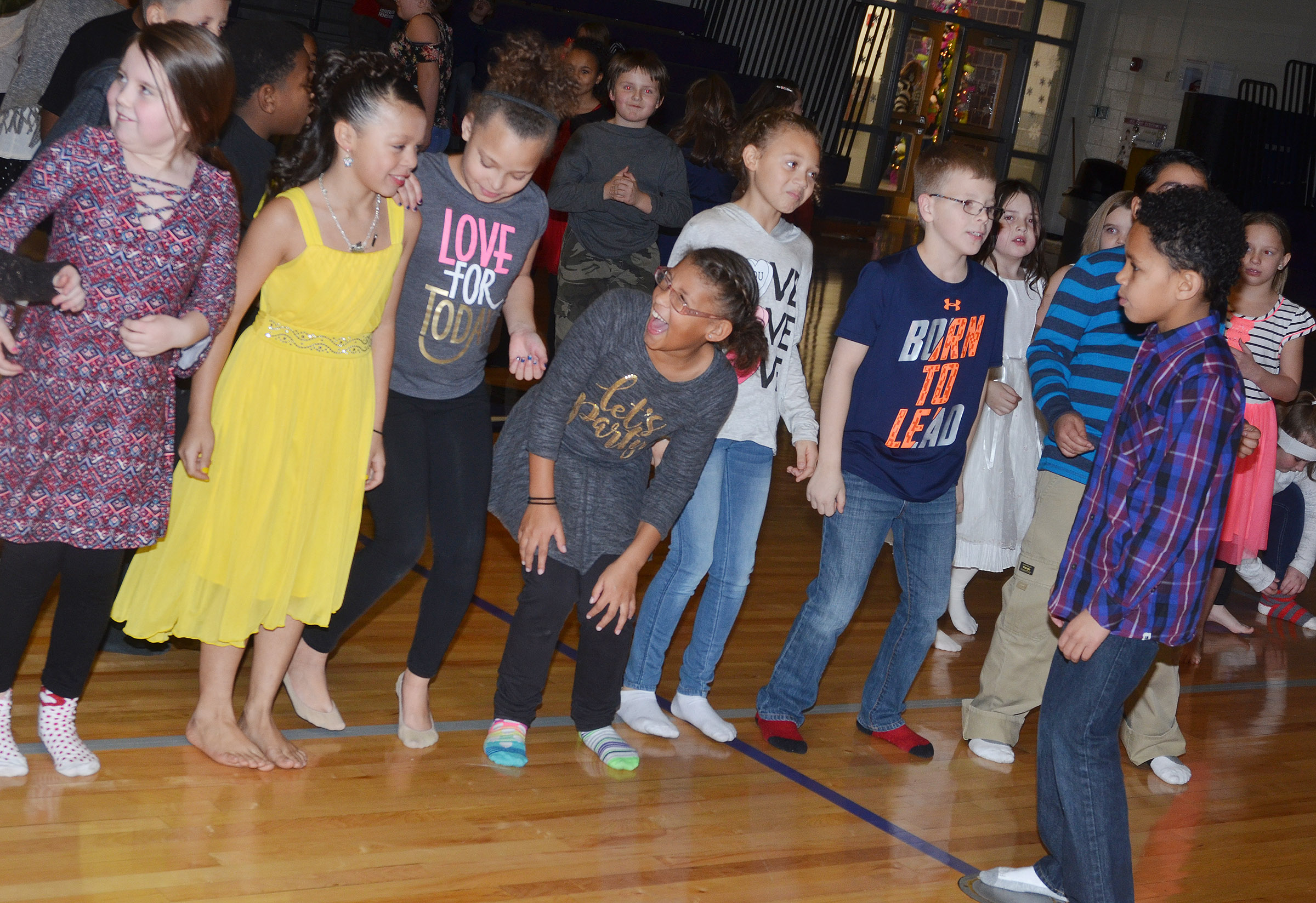 CES students have fun dancing together.