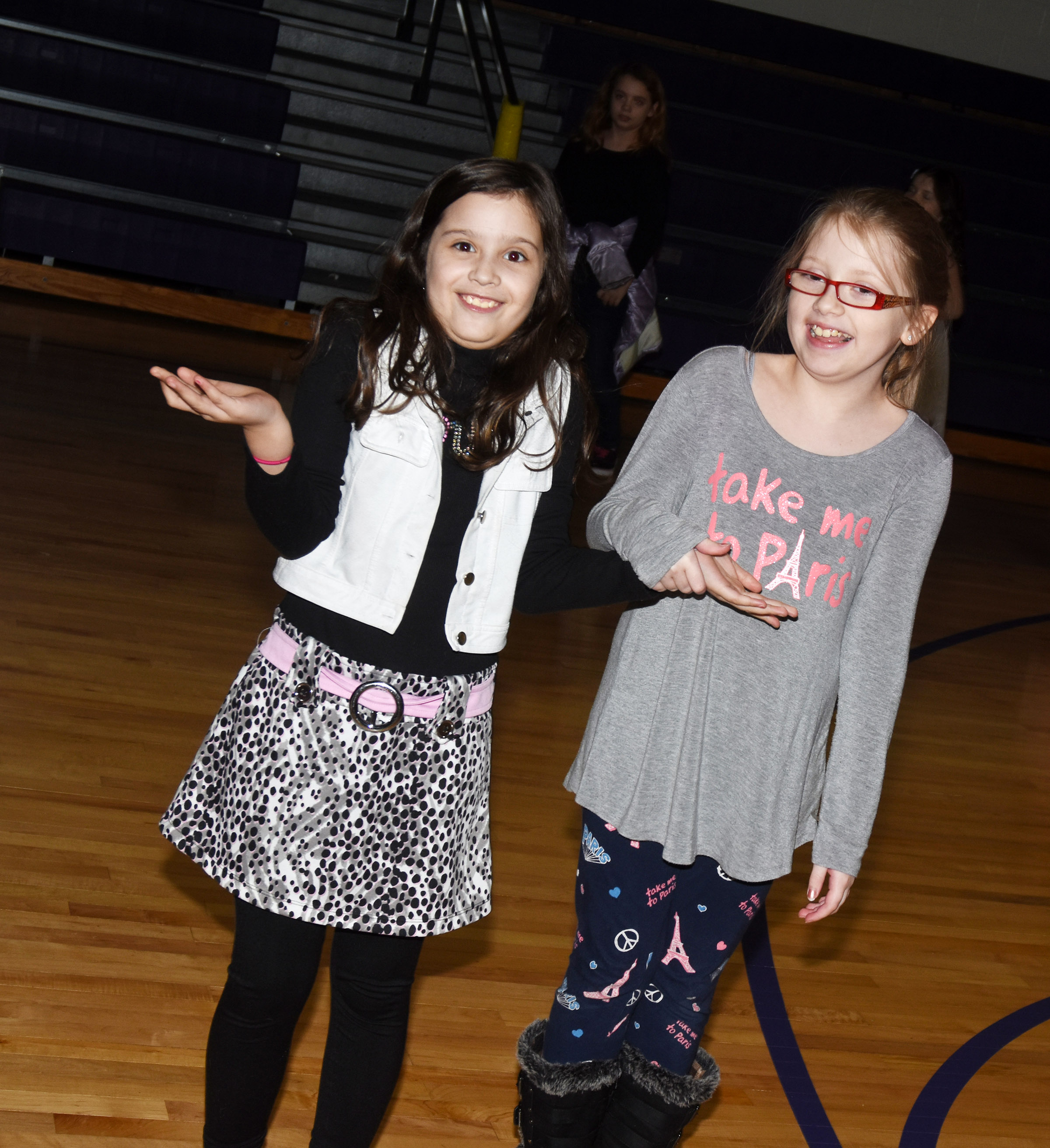 CES fourth-graders Zehavah Negron, at left, and Gracie Pendleton have fun at the dance.
