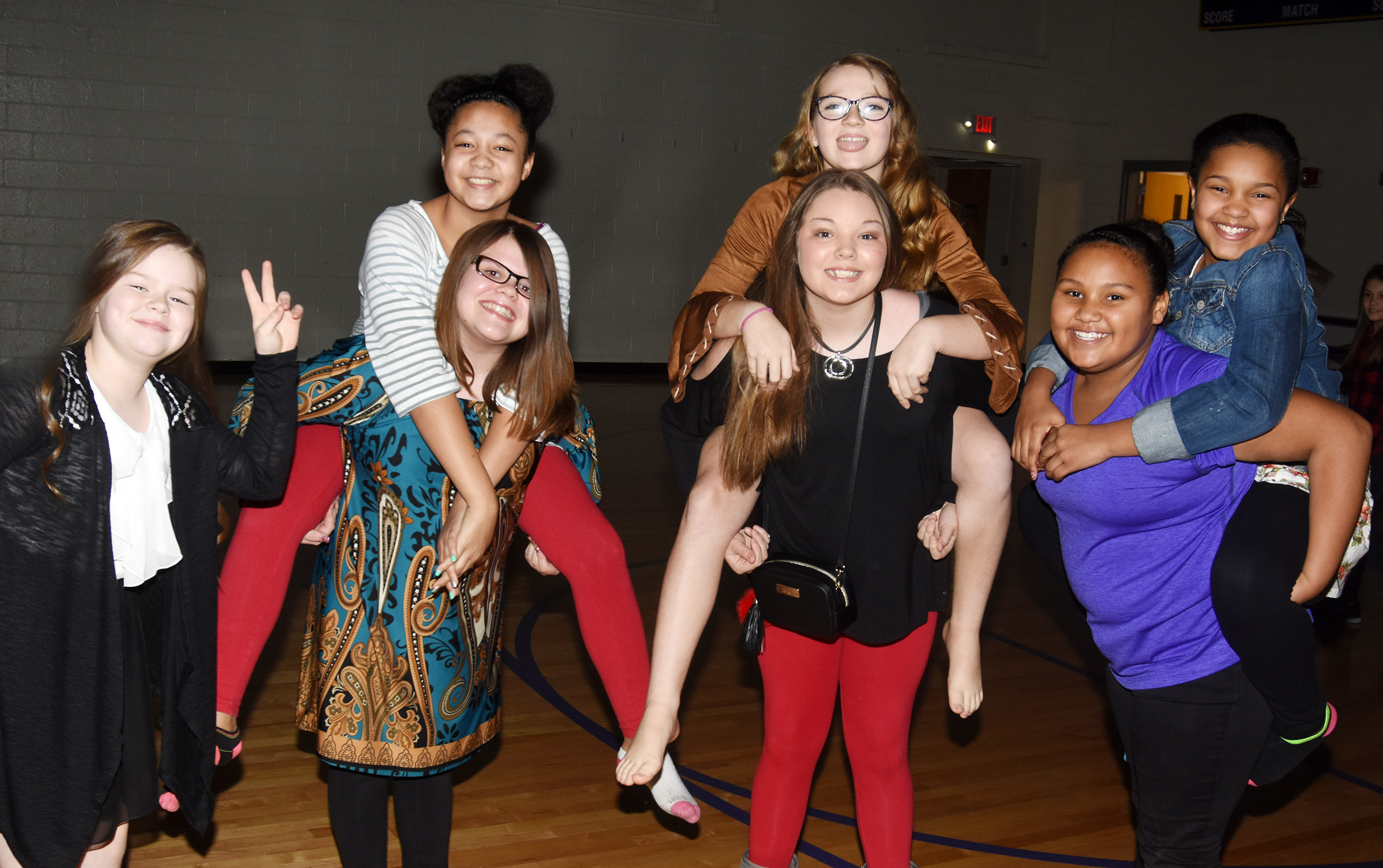 CES fifth-graders have fun at the dance. From left are Miley Hash, Keely Dicken holding Kenya Bridgewater, Piper Maggard holding Lilyan Murphy and Dezarae Washington holding Jaclyn Jackson.