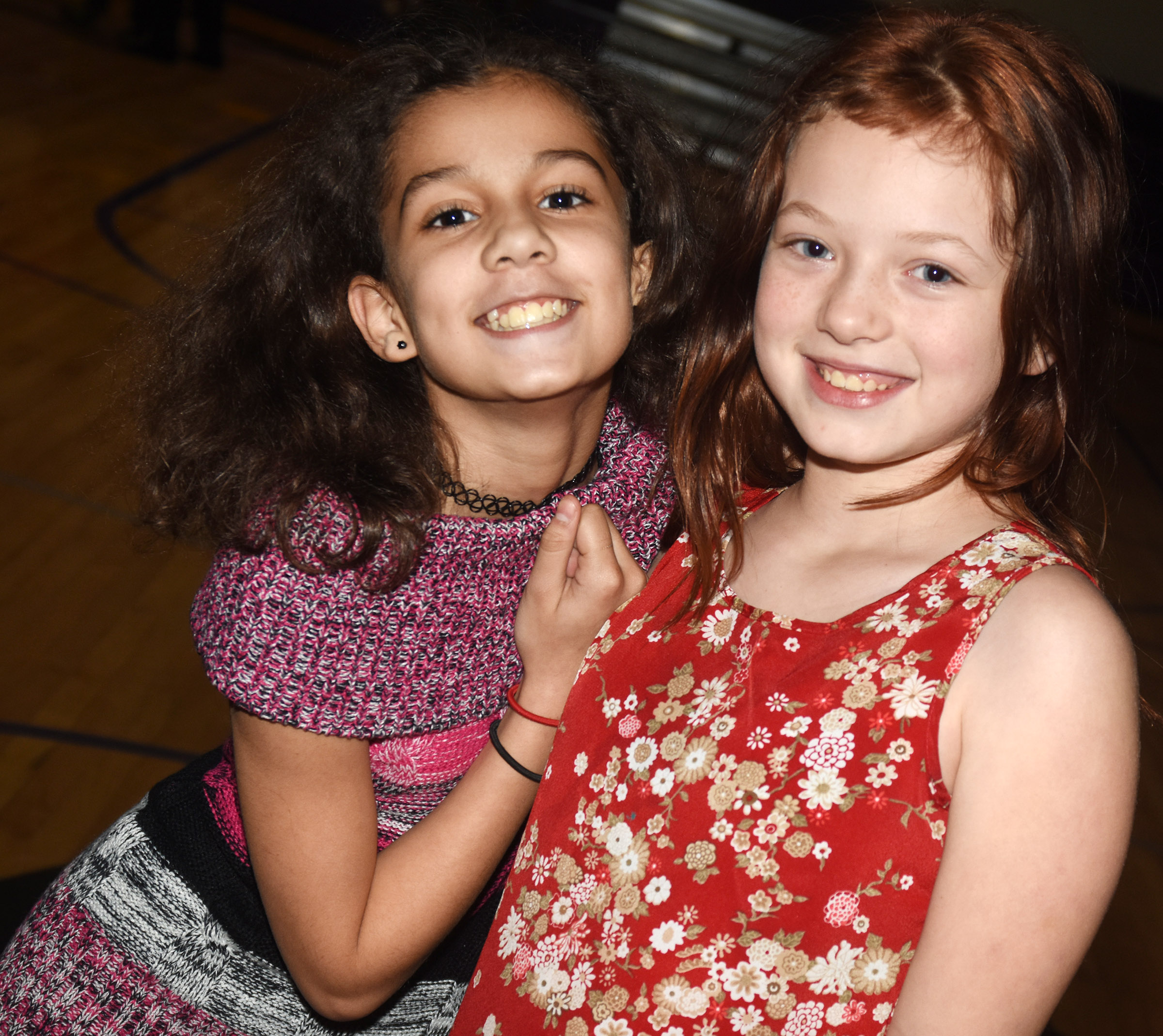 CES fifth-graders Mackenzie Negron, at left, and Kyra Parker pose for a photo at the dance.