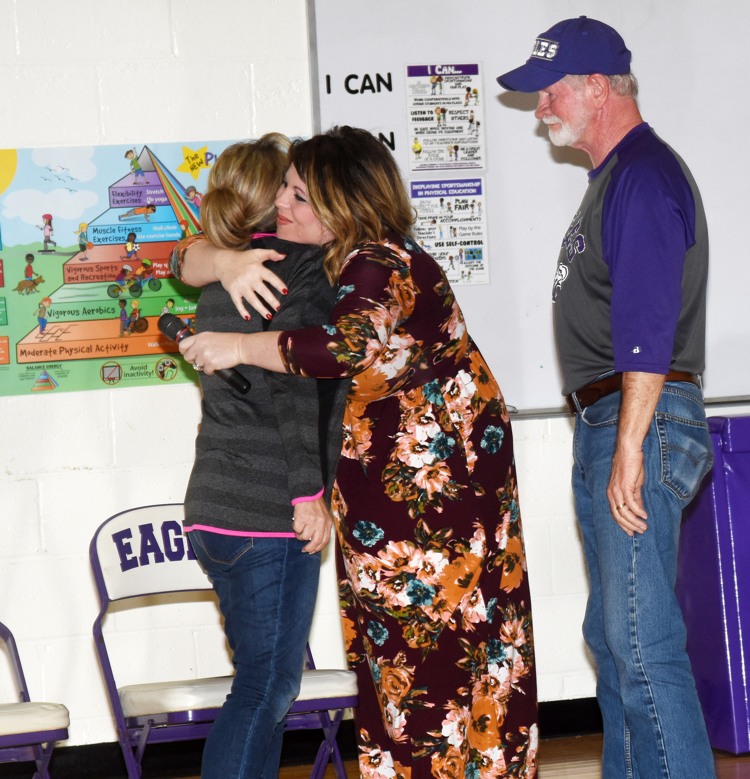 CES Principal Elisha Rhodes hugs Betty Ford, whose husband Daryl Ford, a custodian at CES, is retiring after working for Campbellsville Independent Schools for nearly 30 years.