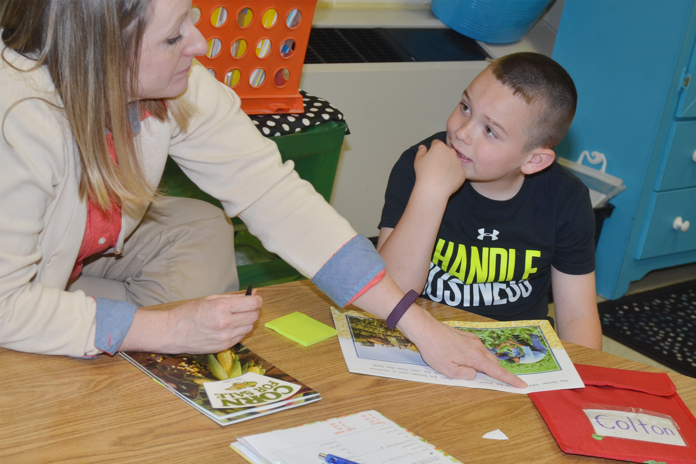 CES teacher Laura Dicken reads with first-grader Colton Maggard.