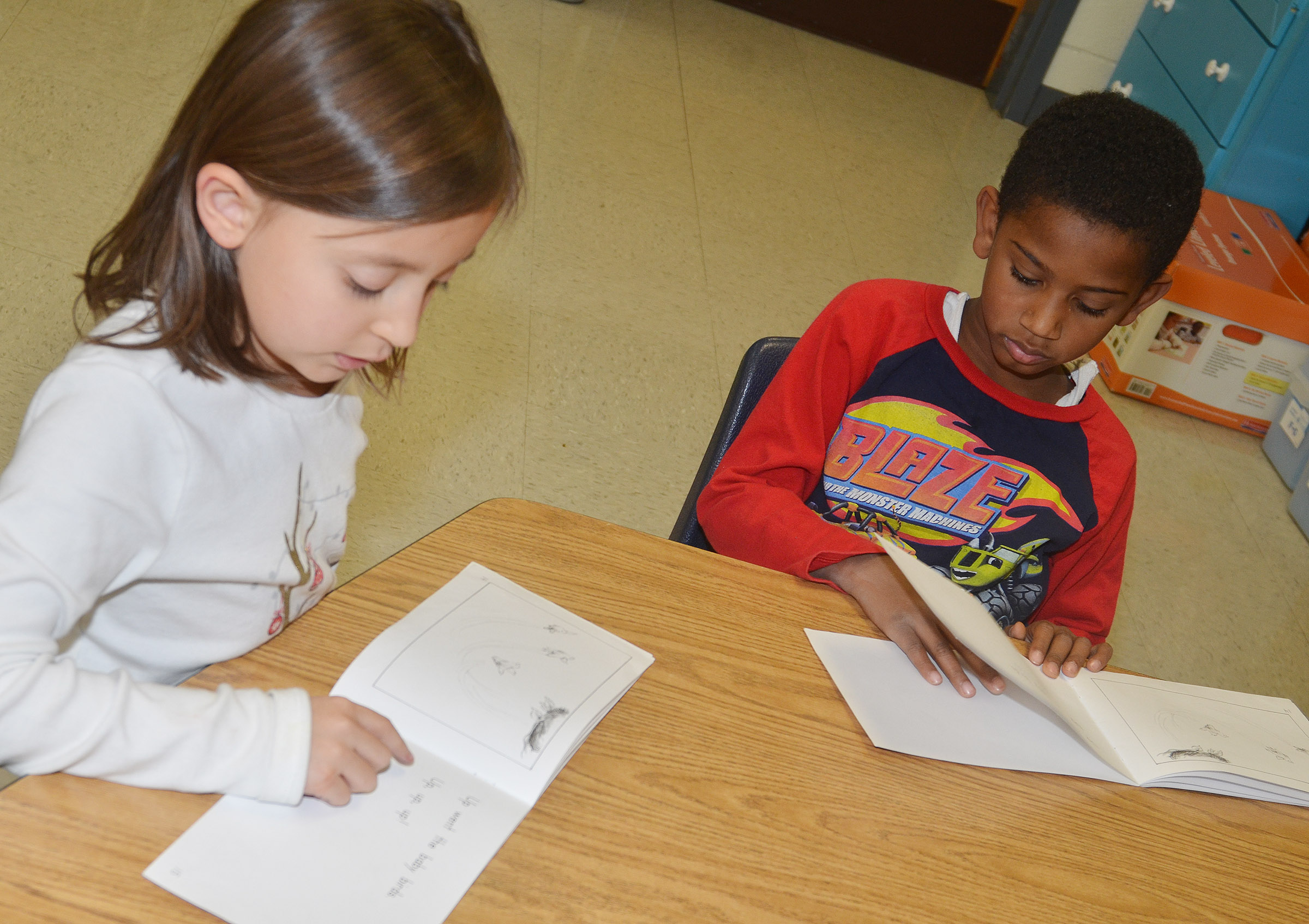 CES first-graders Gabriella Tate, at left, and Kasen Smith practice reading contractions.