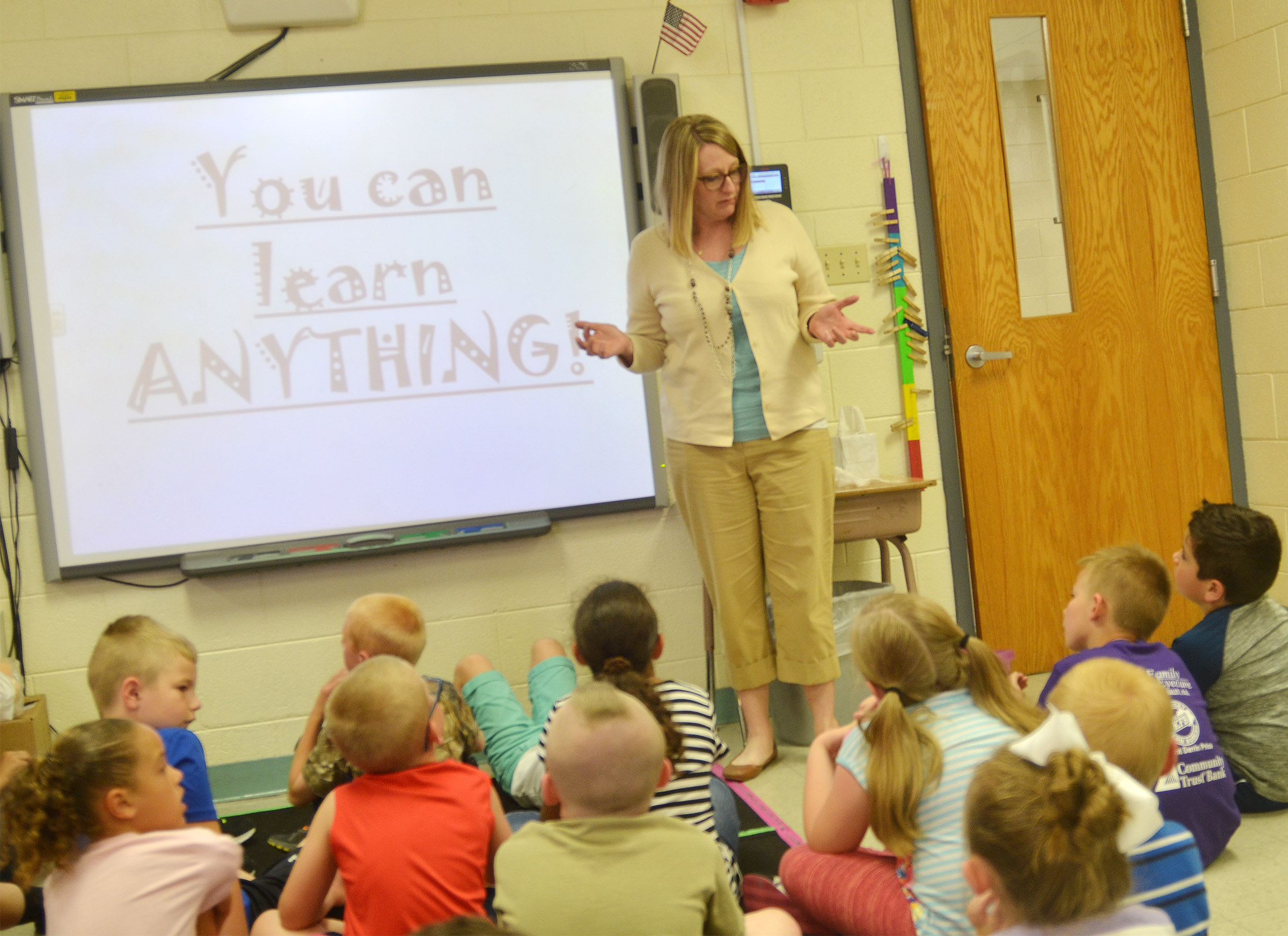 CES reading interventionist Laura Dicken encourages first-graders to don't give up on learning how to do new activities, just because they can't do some of them now.