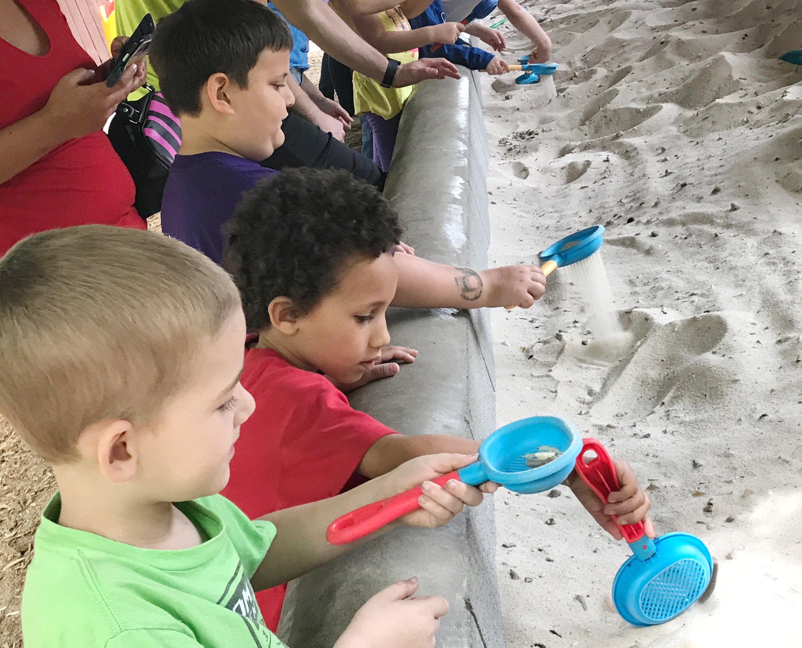 CES kindergarteners, from left, Mason Edwards, Jaxon Williams and Cloud Malone dig for fossils.