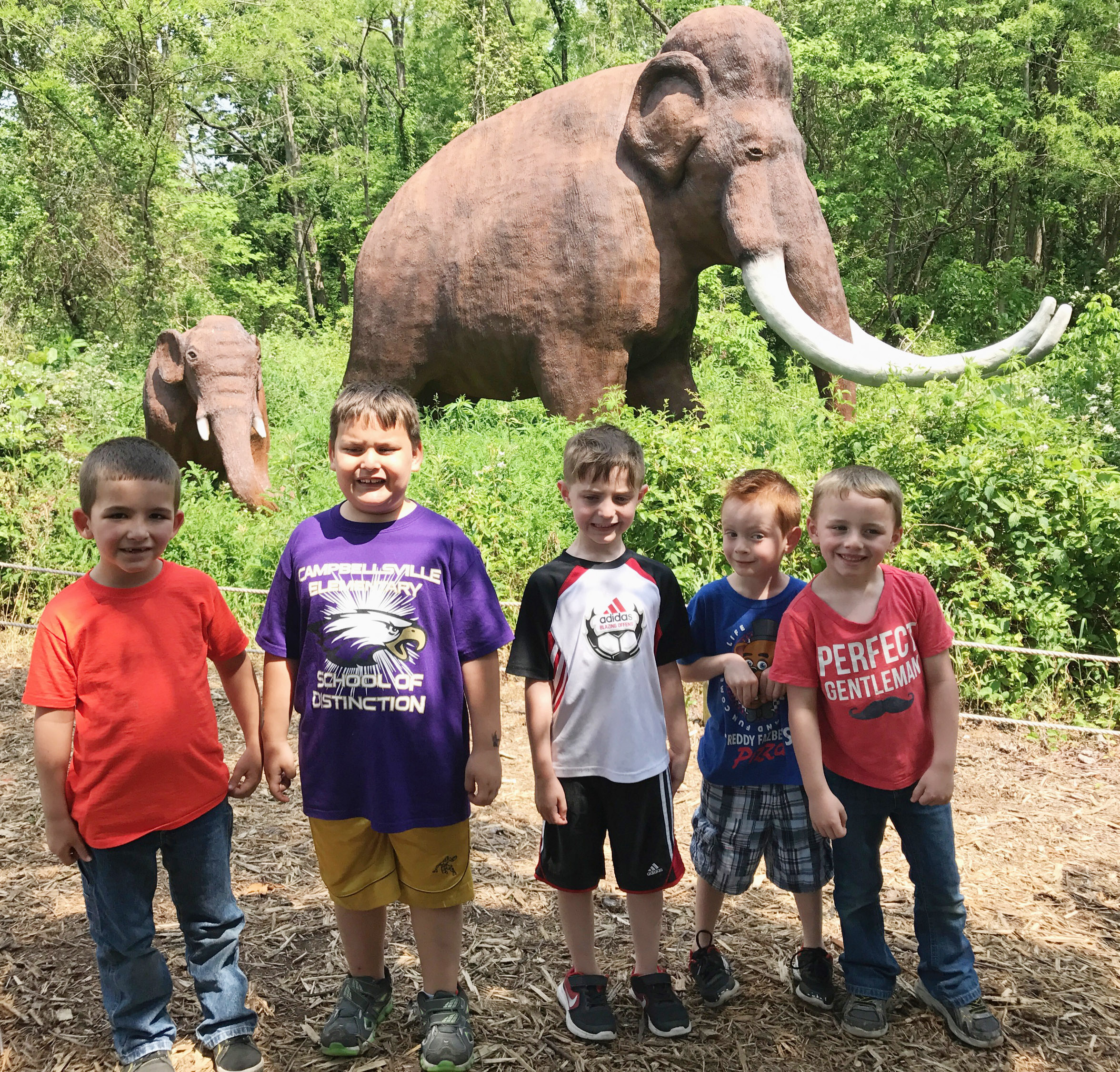 From left, CES kindergarteners Josiah Edwards, Cloud Malone, Caleb Goodson, Mason Edwards and Ronnie Allen pose with a dinosaur.