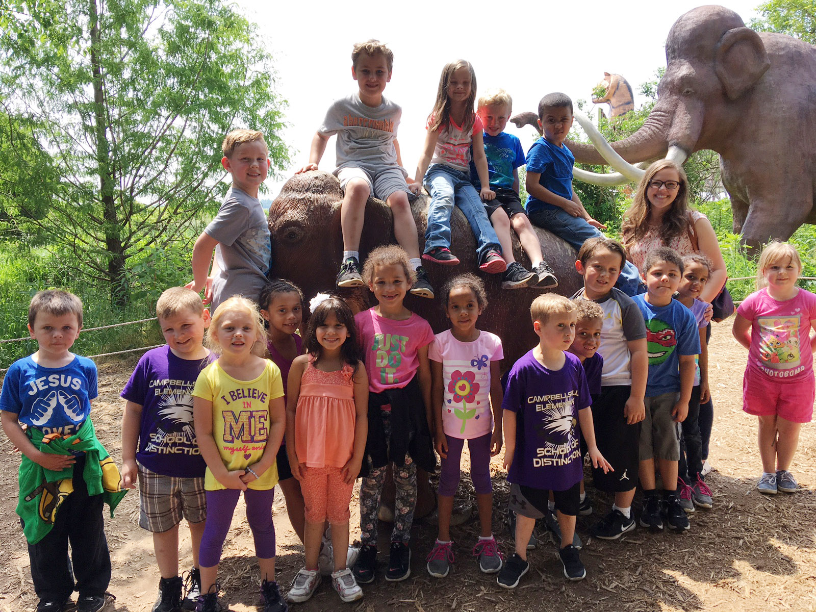 CES kindergarteners in Lisa Wiseman's class pose with a dinosaur.