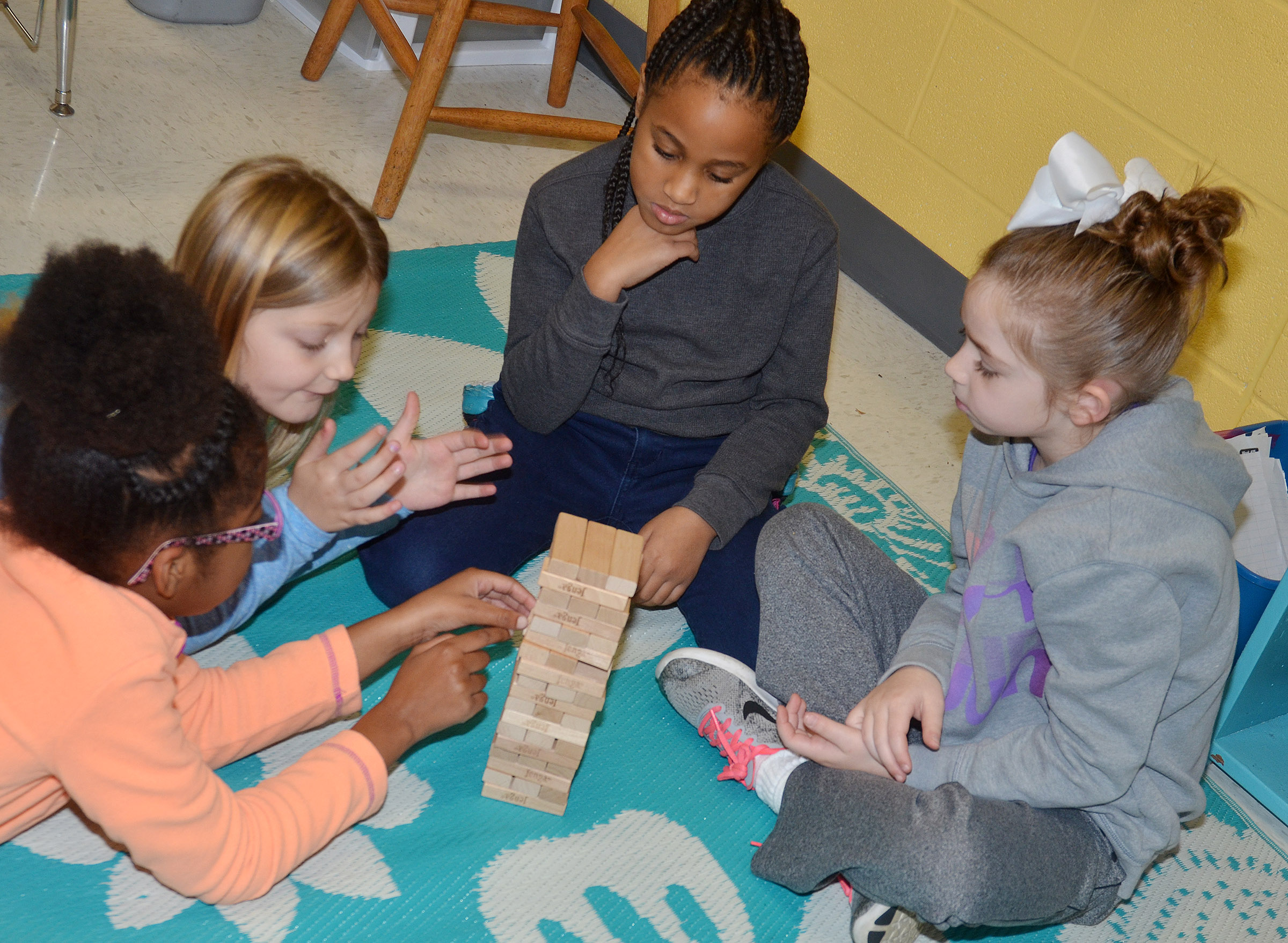 CES second-graders, from left, Willow Griffin, Asia Singleton, Kadance Ford and Lainey Price play Jenga.
