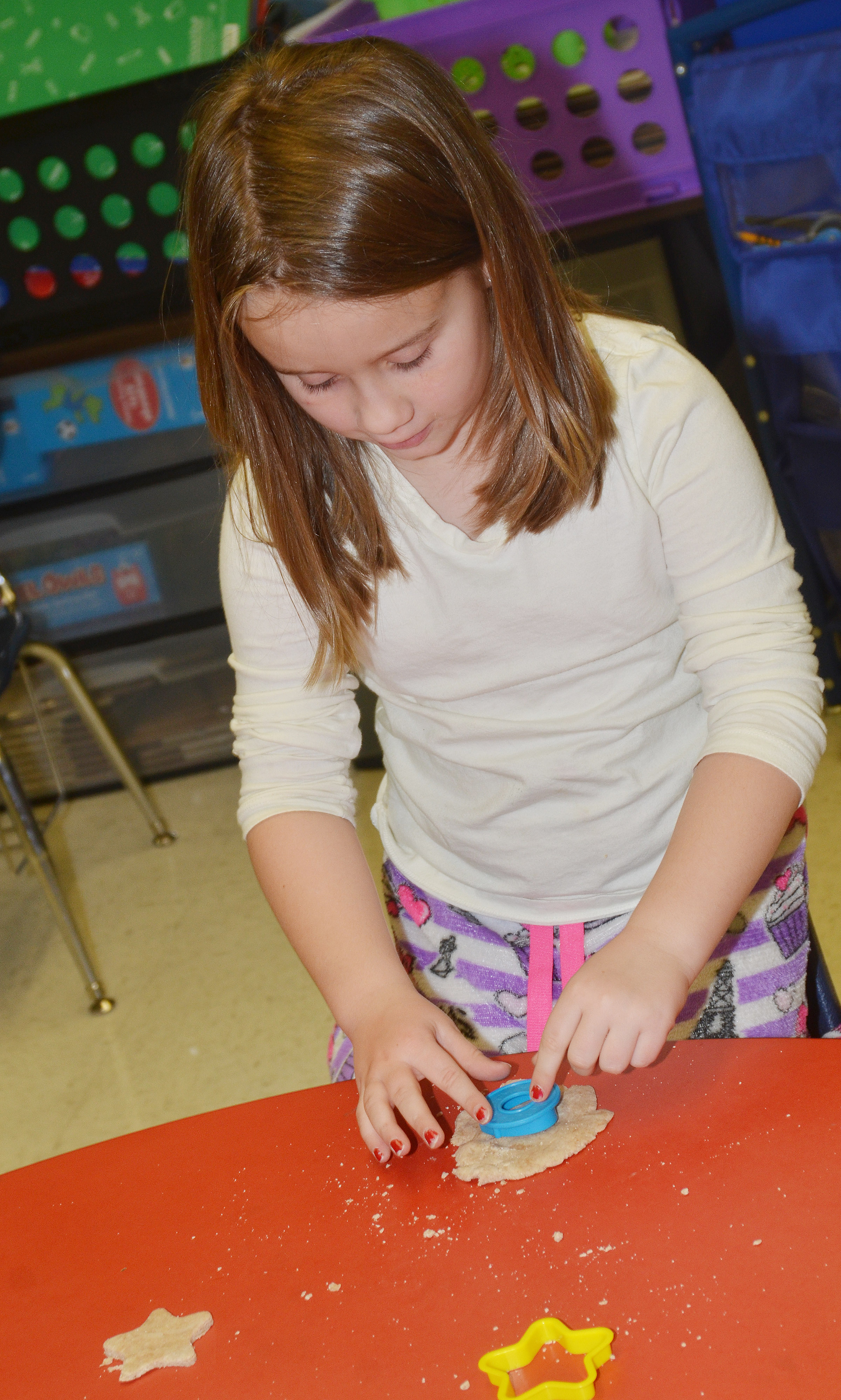 CES first-grader Natalee Shaw plays with Play-Doh.