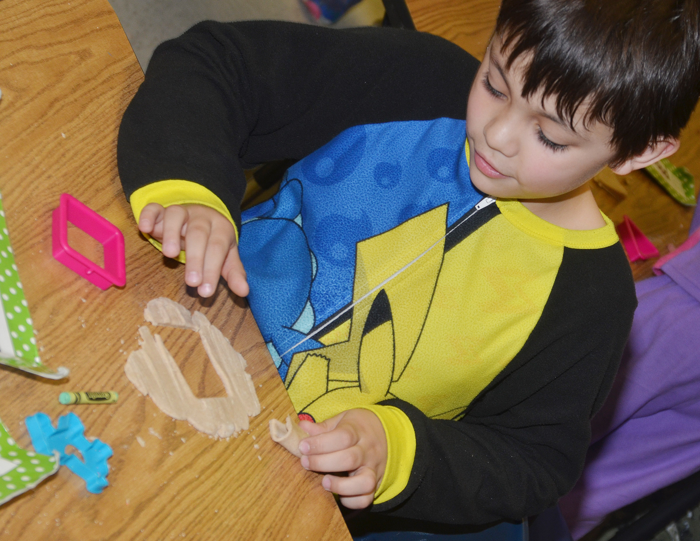 CES first-grader Keagan Shearer plays with Play-Doh.