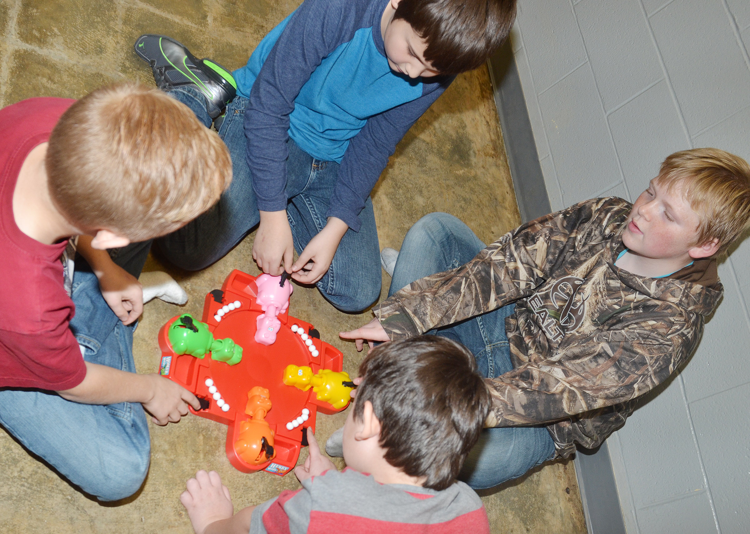 CES fifth-graders play Hungry Hungry Hippos. Facing are Mason Fisher, at left, and Simon Wilkerson.