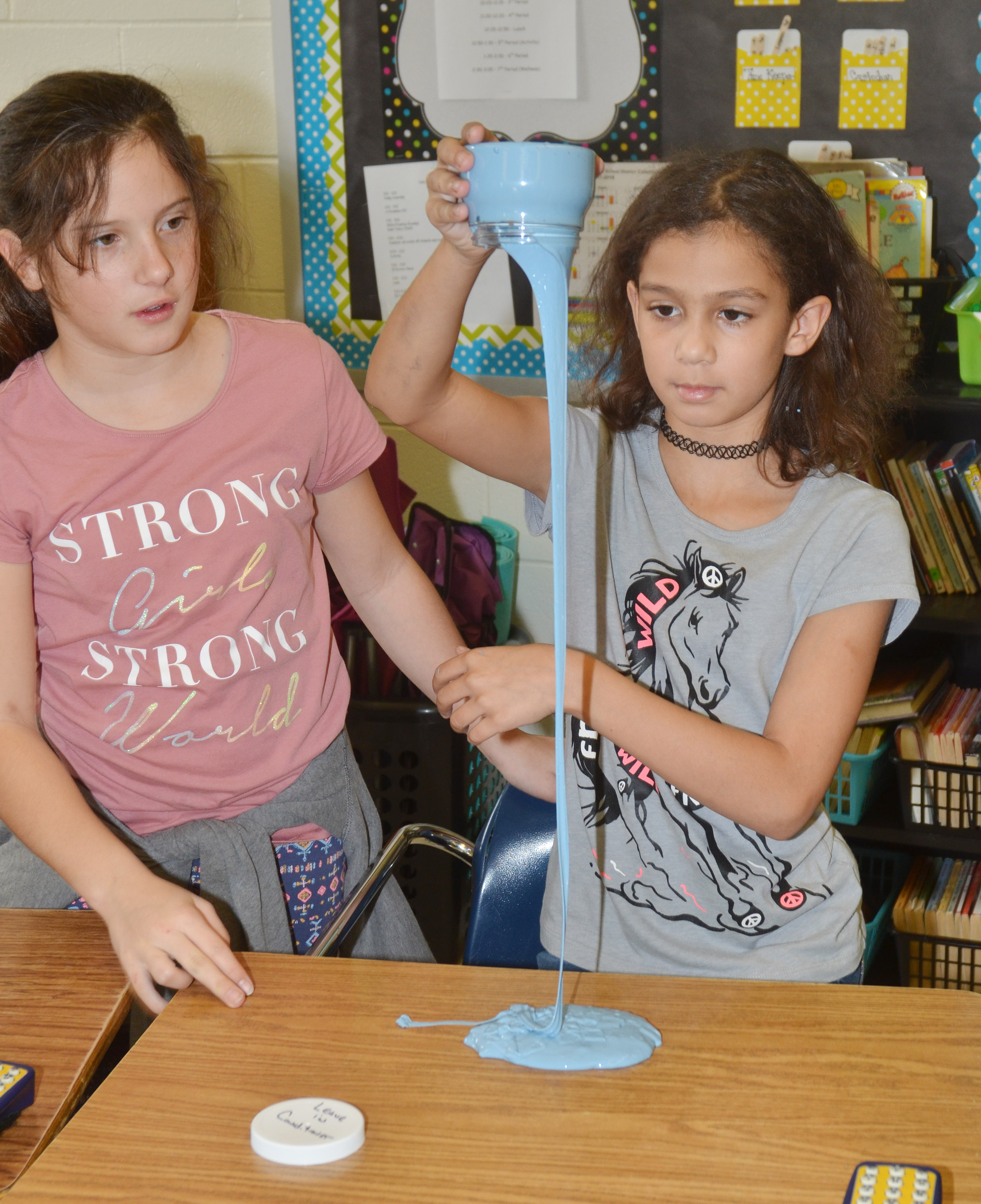CES fifth-graders Chloe Hoppes, at left, and Mackenzie Negron play with slime.