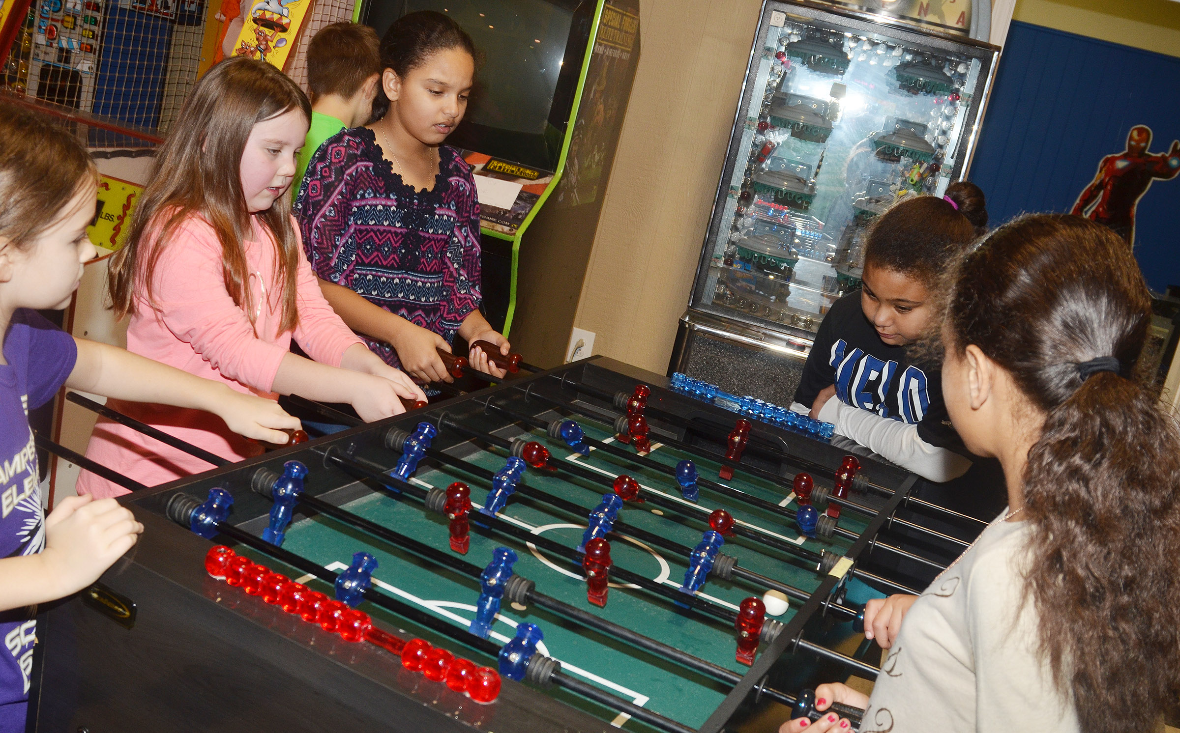 CES fourth-graders play air hockey.