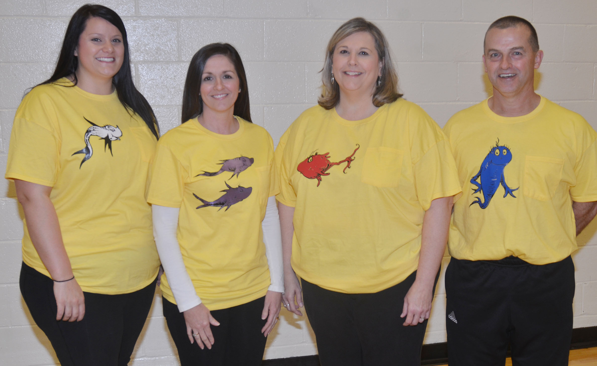 "CES activity teachers dress as characters from ""One Fish, Two Fish, Red Fish, Blue Fish."" From left are CES Explorers teacher Miriah Cox, art teacher Adrienne Hash, music teacher Cyndi Chadwick and physical education teacher Lynn Kearney."
