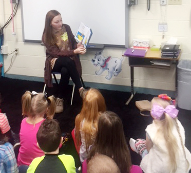 CU education student Keeahna Bowen reads a Dr. Seuss book to CES first-grade students.