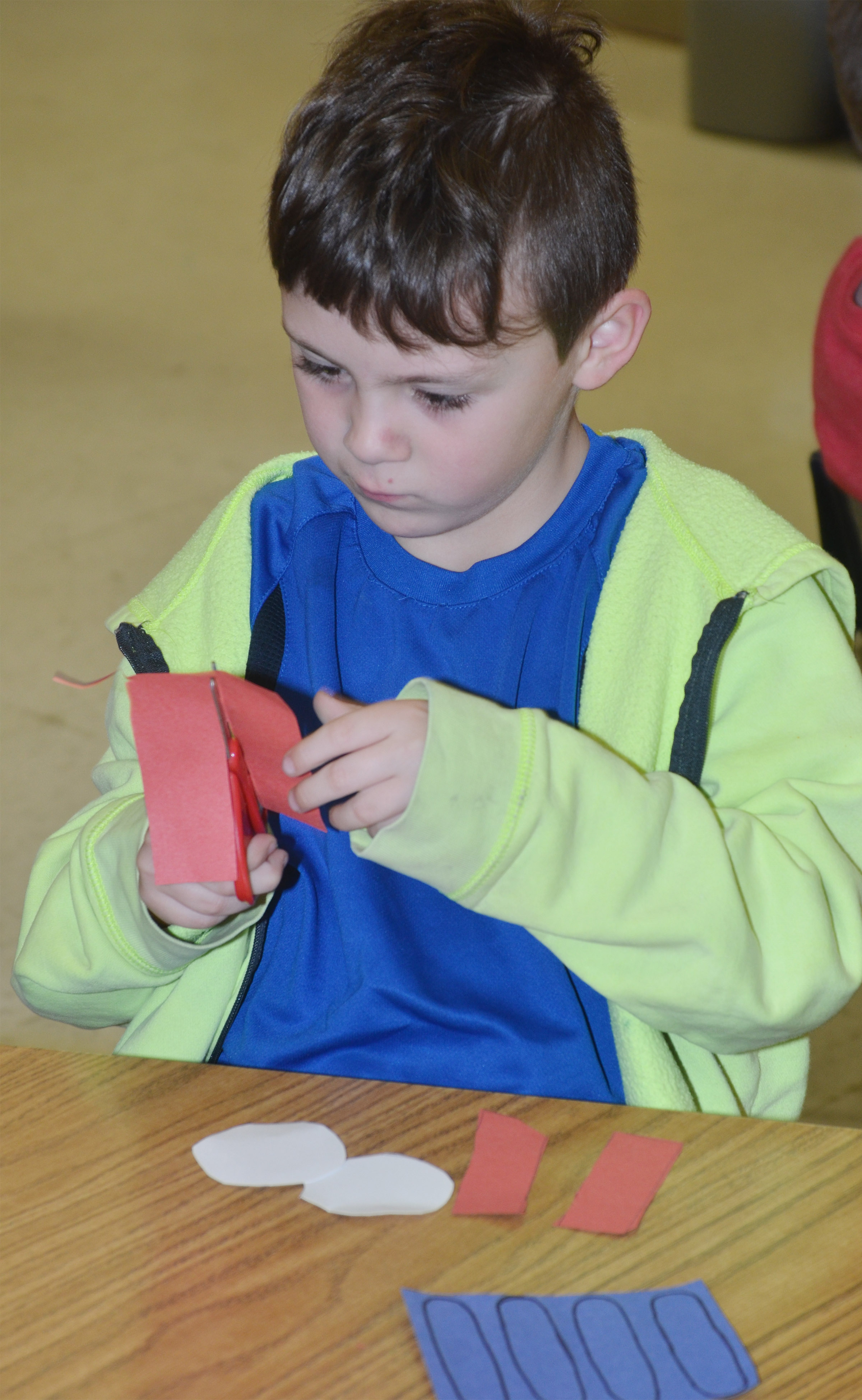 CES kindergartener Bentley Shively cuts out the pieces to his Thing 1 character.
