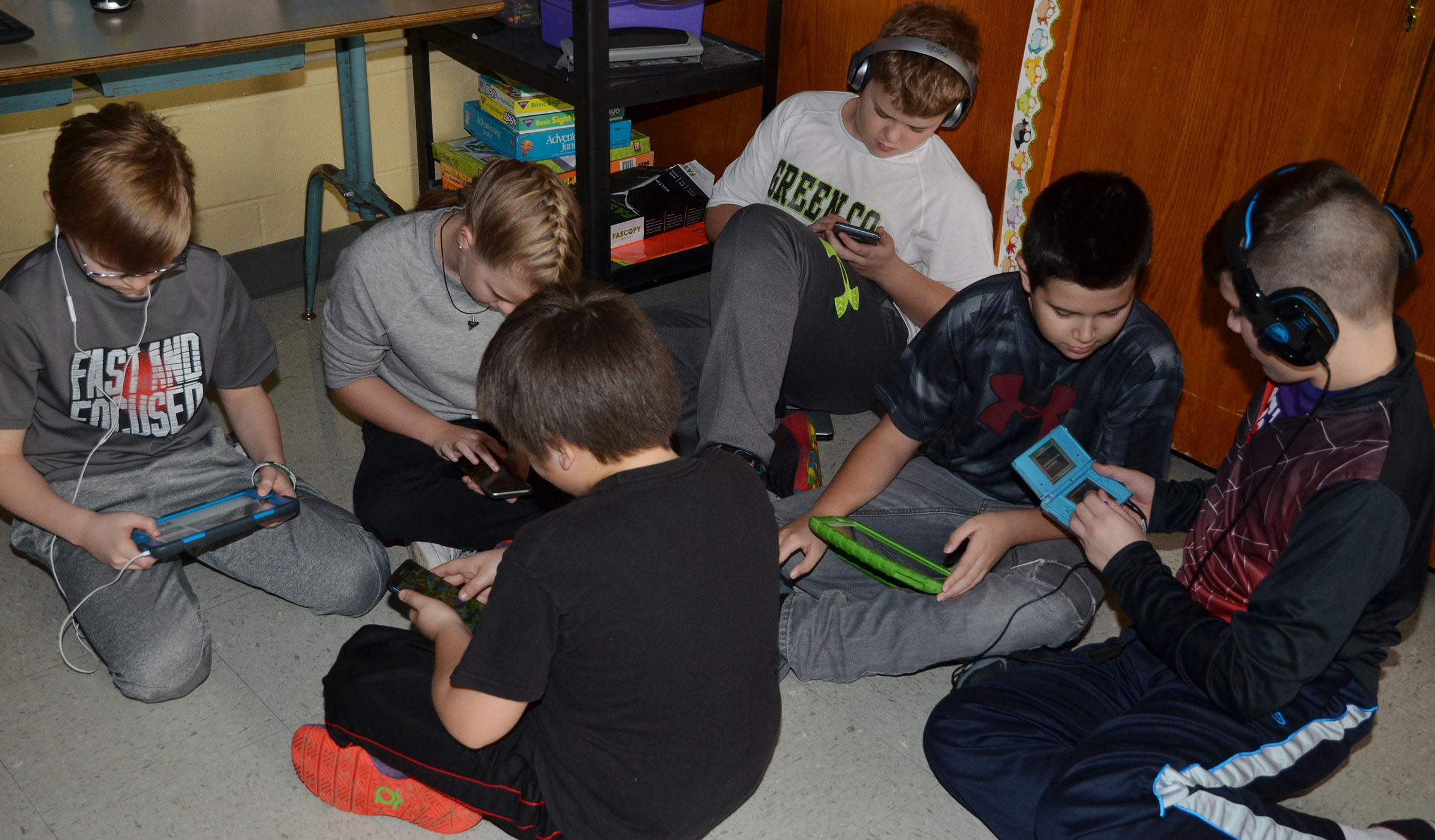 CMS students enjoy electronic device time together.