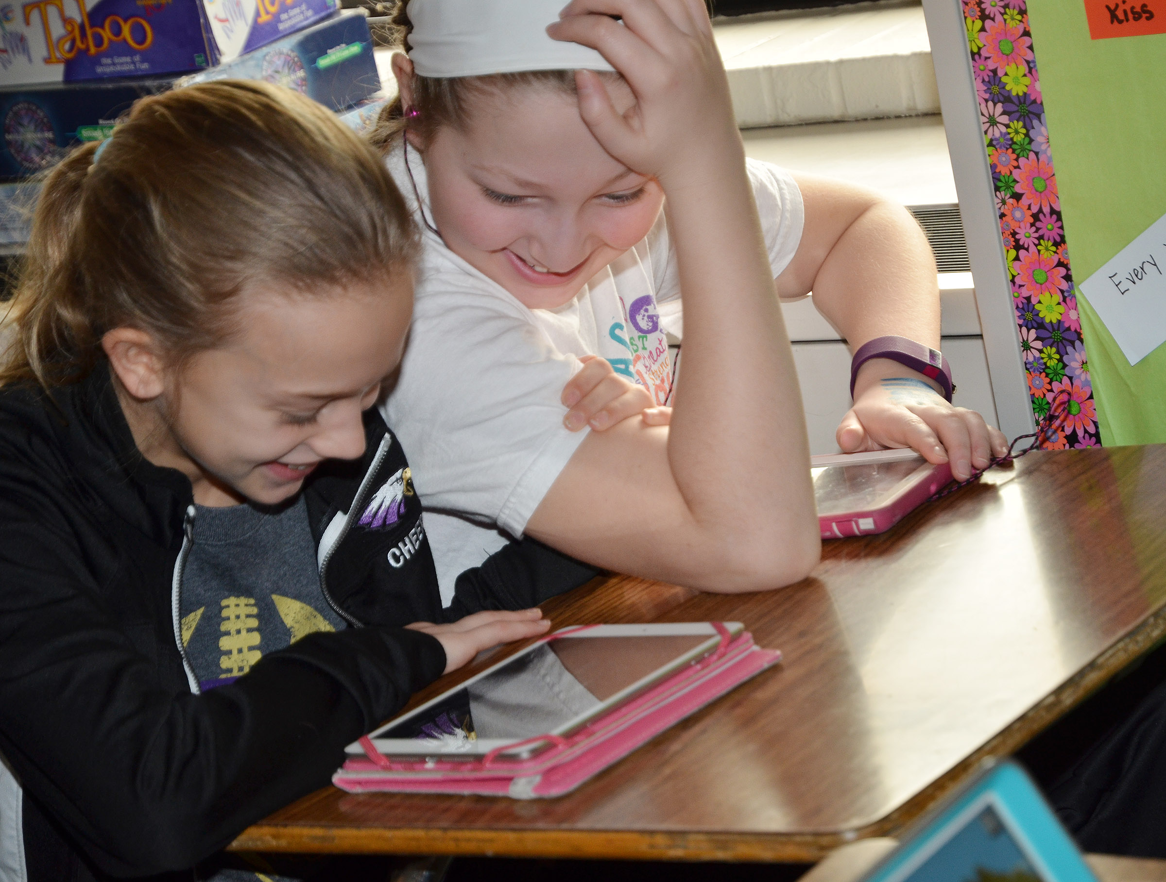 CMS fifth-graders Chloe Thompson, at left, and Ava Hughes enjoy electronic device time.