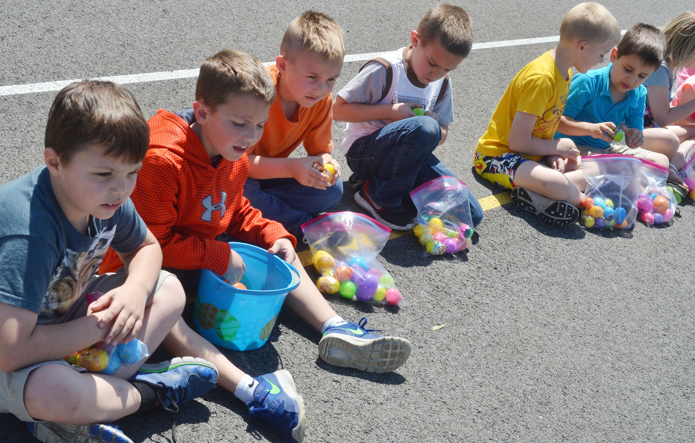 CES first-graders look at the prizes they found in their Easter eggs.