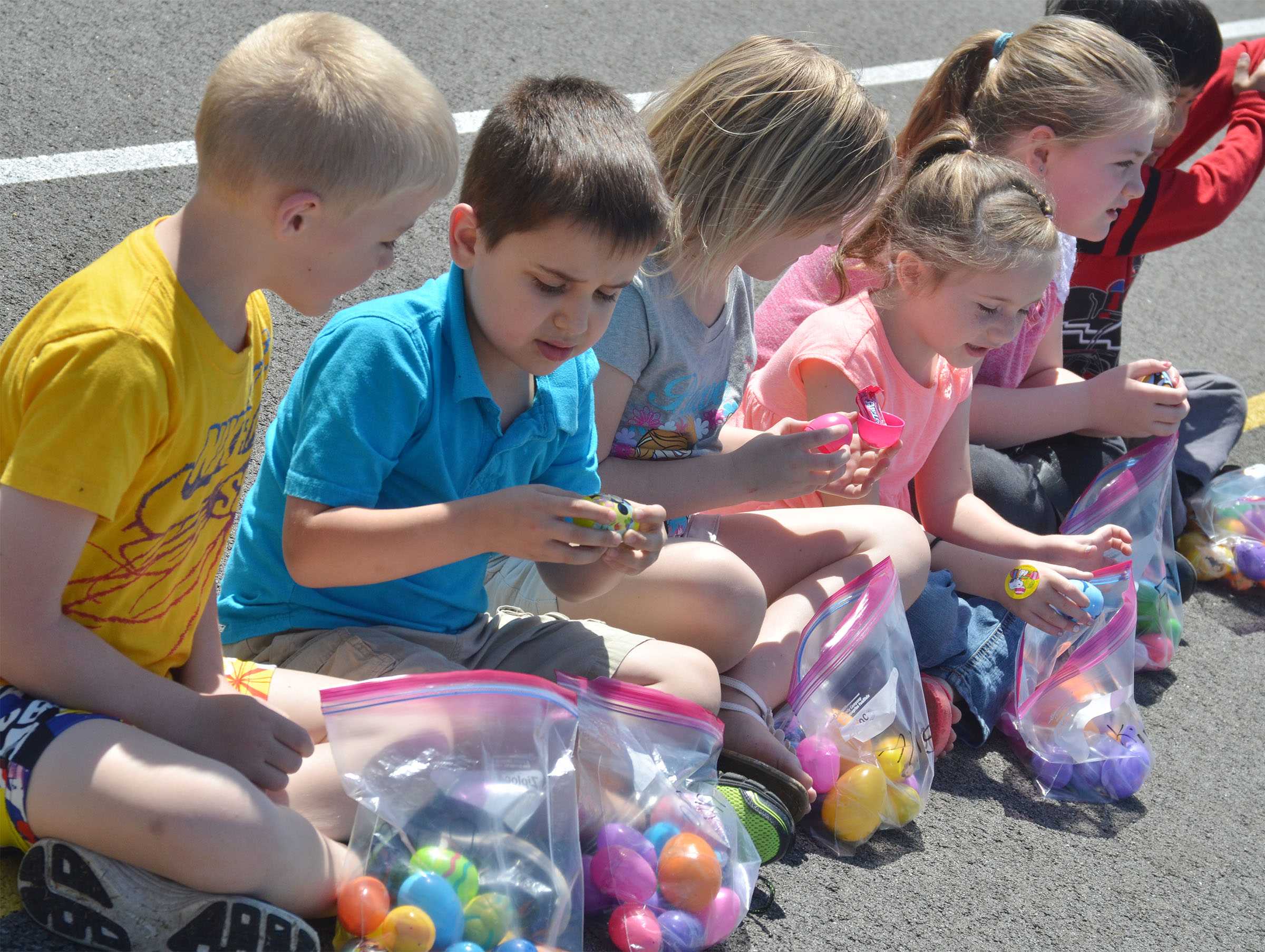 CES first-grader Aaron Floyd opens an Easter egg to see what's inside.