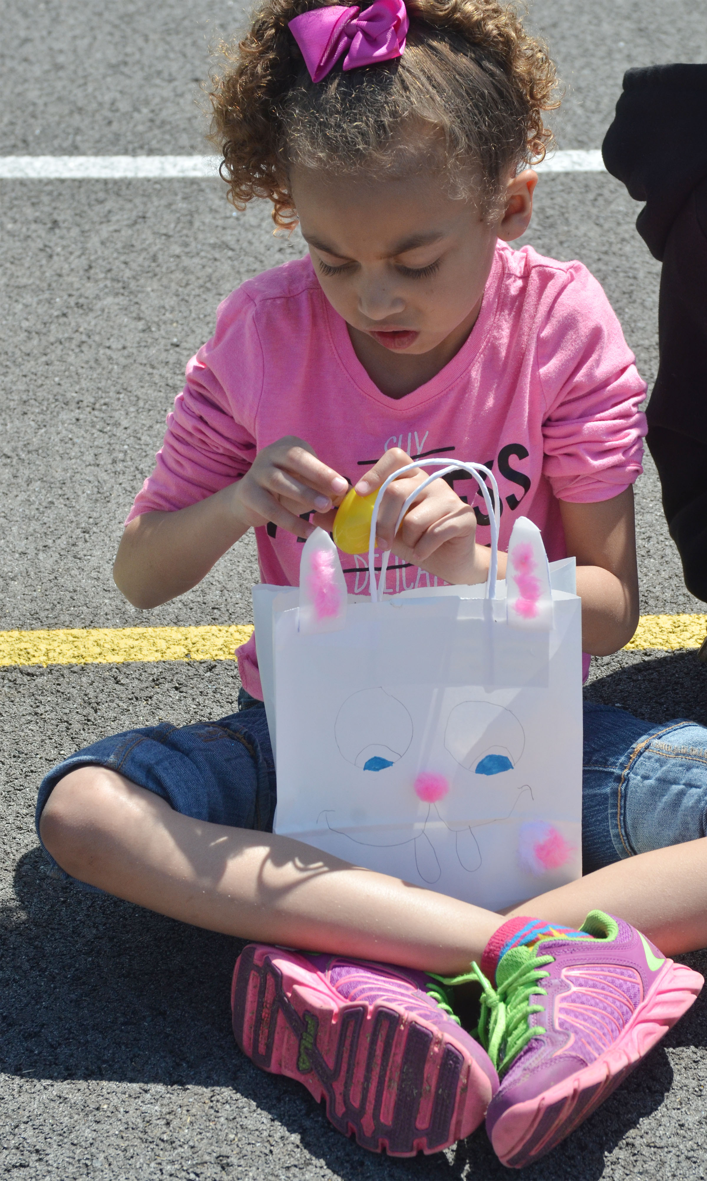 CES first-grader Londyn Smith opens an Easter egg.