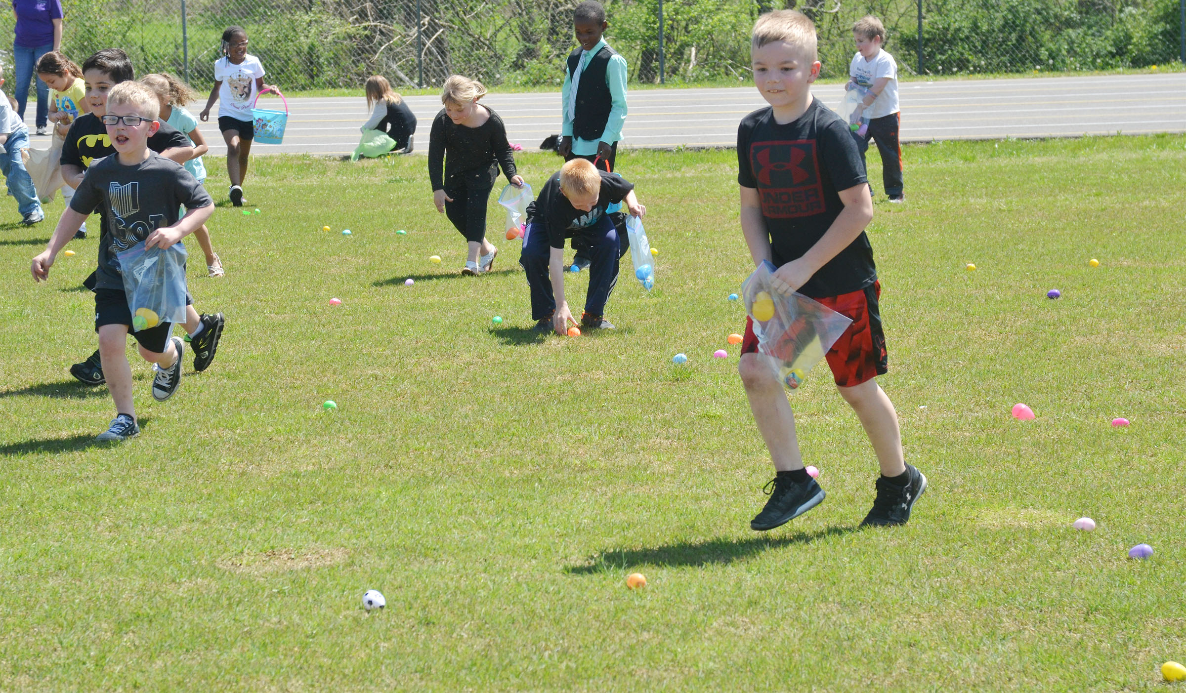 CES first-graders search for Easter eggs.