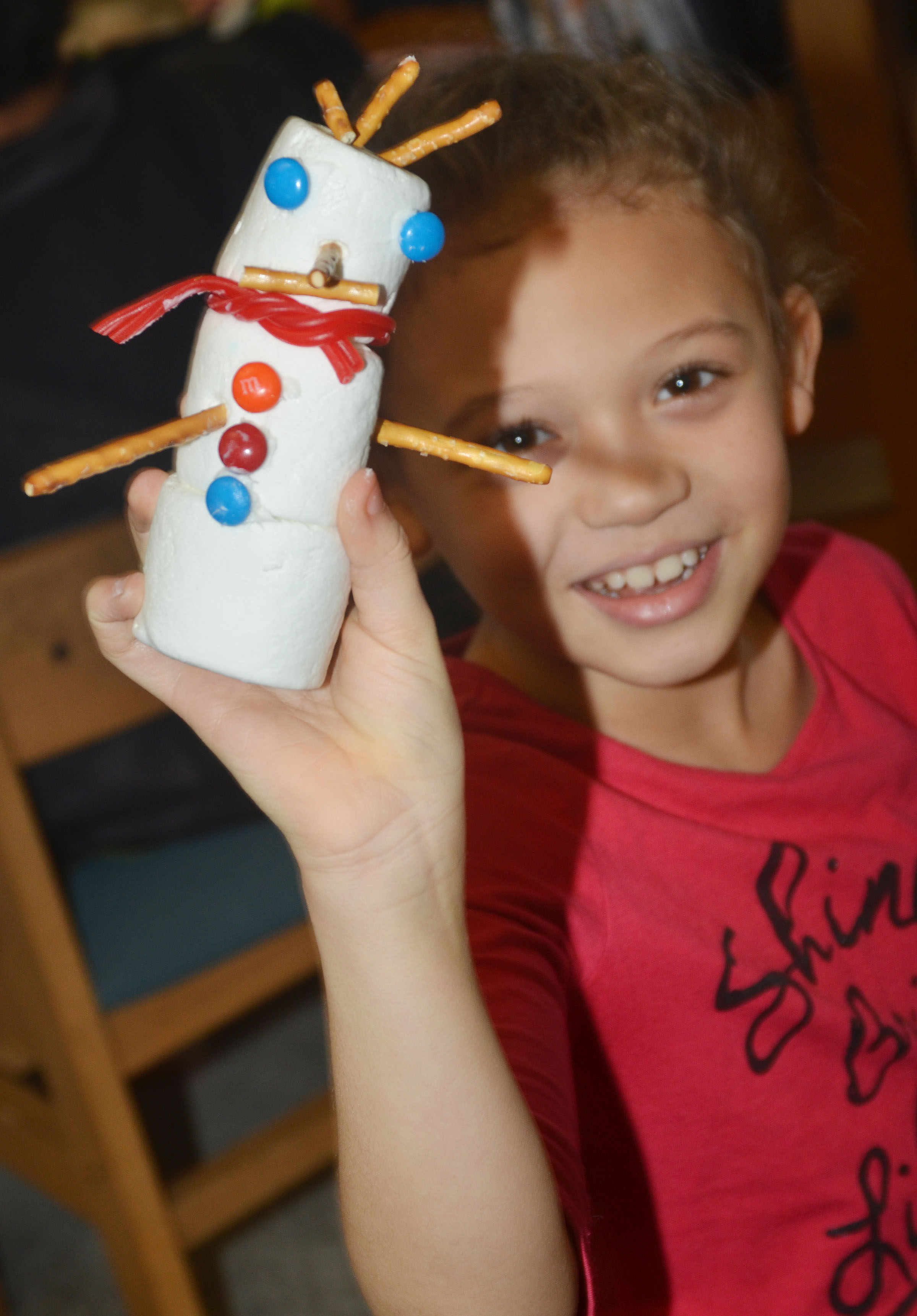 CES third-grader Alicia Spaulding holds her finished edible snowman.