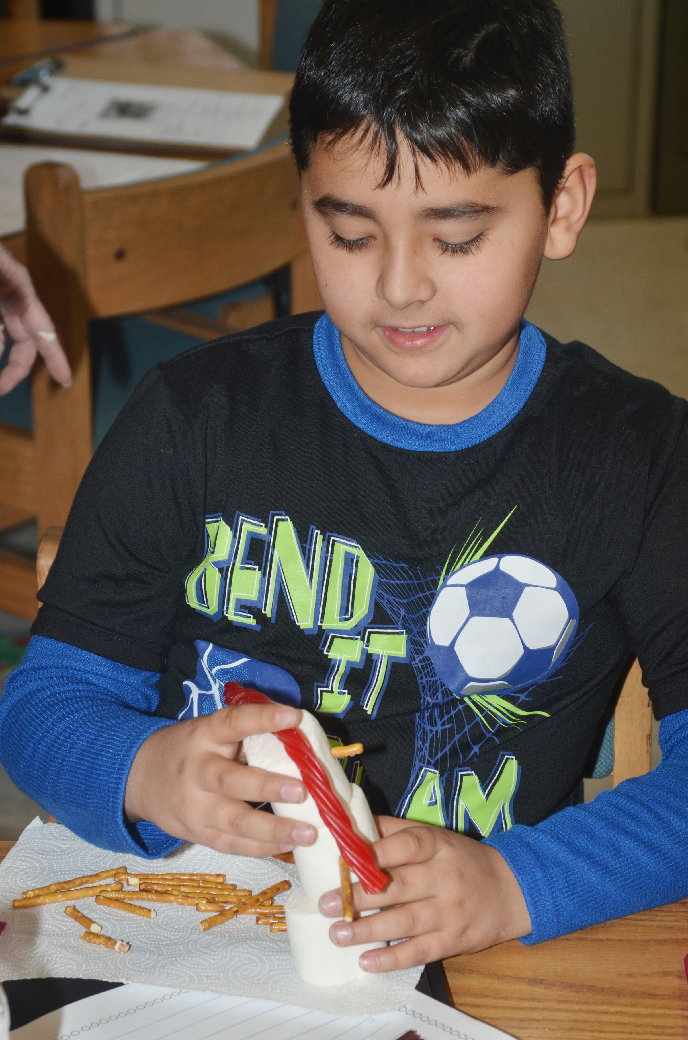 CES third-grader Cody Tamez builds his edible snowman.